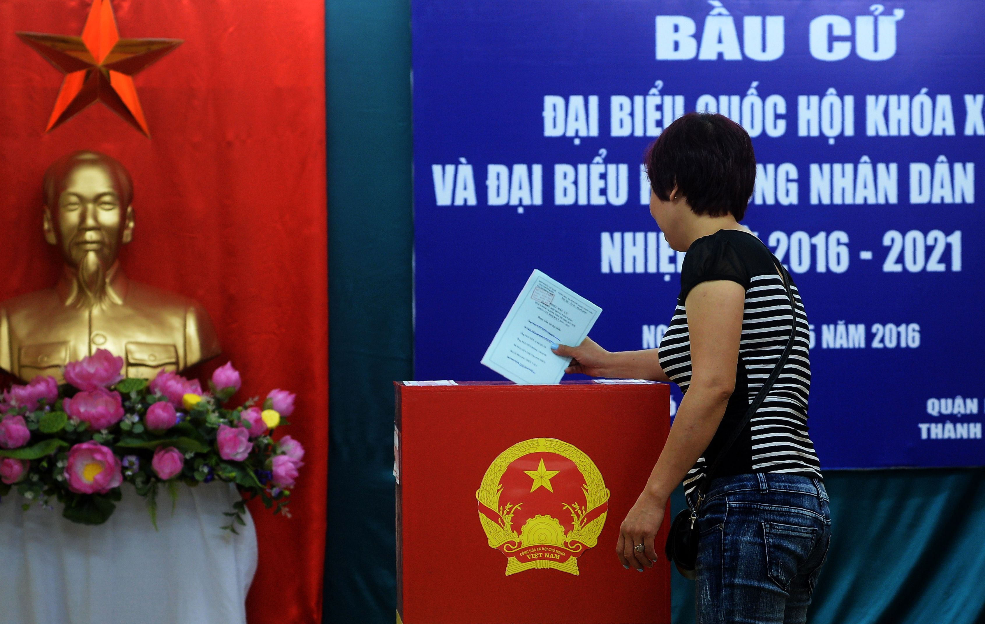 A woman casts her ballot at a local voting station in Hanoi on May 22, 2016