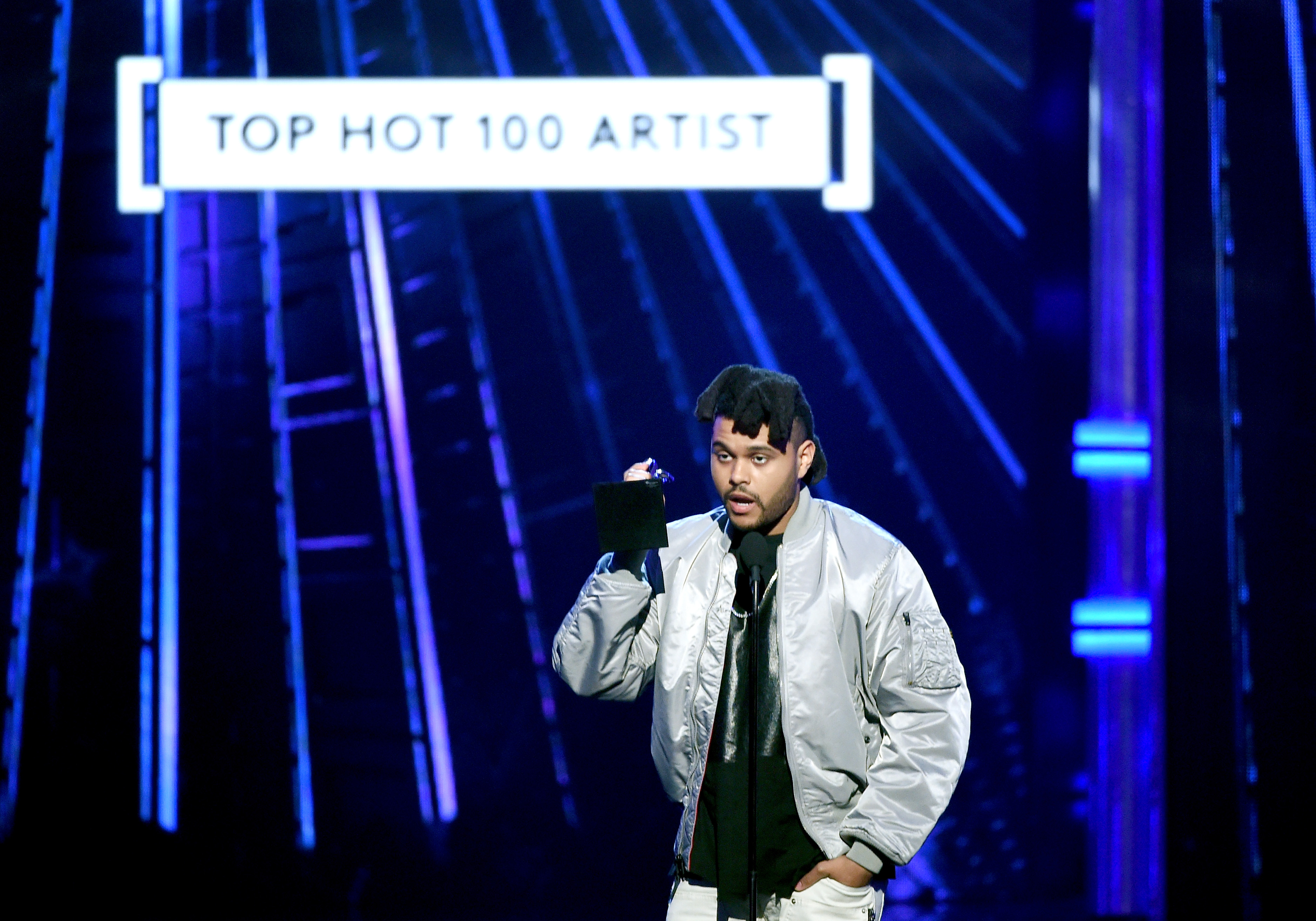 Recording artist The Weeknd accepts the Top Hot 100 Artist award onstage during the 2016 Billboard Music Awards at T-Mobile Arena on May 22, 2016 in Las Vegas, Nevada.