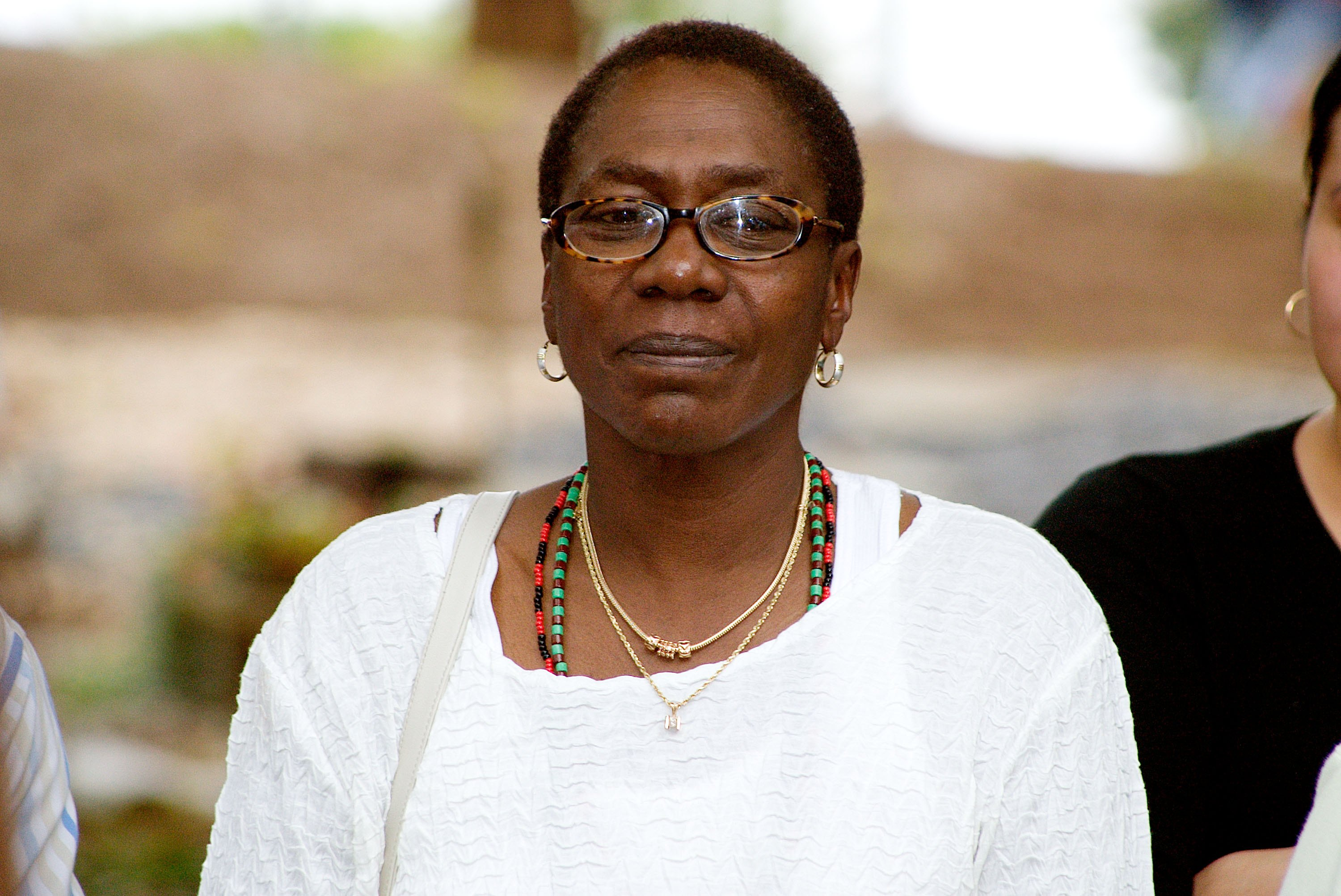 Afeni Shakur-Davis, mother of the late Tupac Shakur, watches the African drum ceremony marking the tenth anniversary of his death September 9, 2006 in Stone Mountain, Georgia.