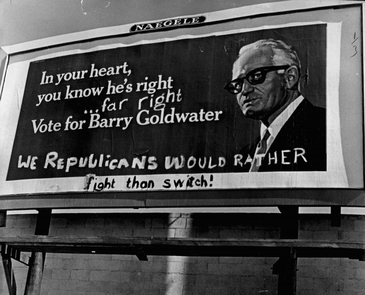 Partisans of both parties were at work on 1964 Barry Goldwater billboard in Denver