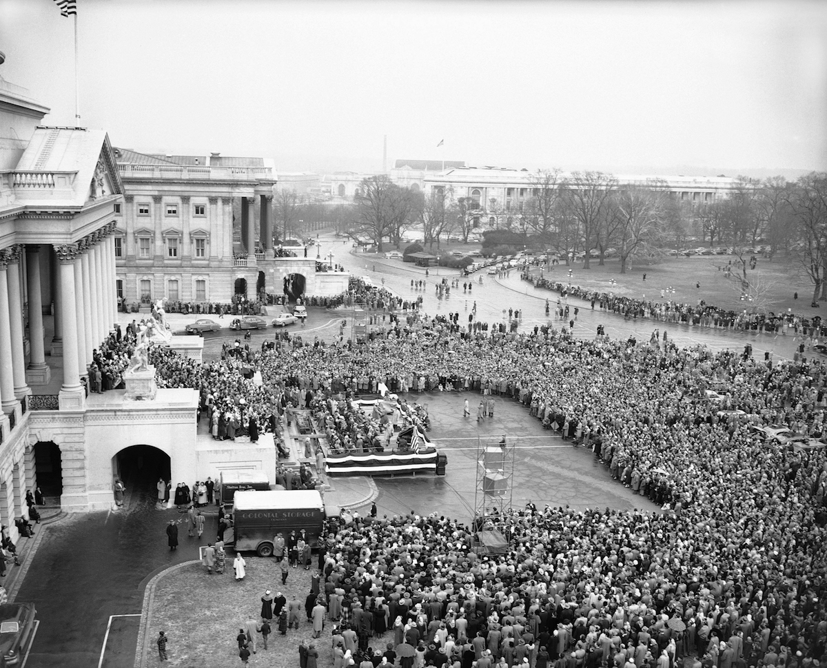 A crowd of several thousand persons stands on capitol plaza and on the center steps of the U.S. Capitol, left, in Washington  Feb. 3, 1952, to hear Evangelist Billy Graham preach at a rally.
