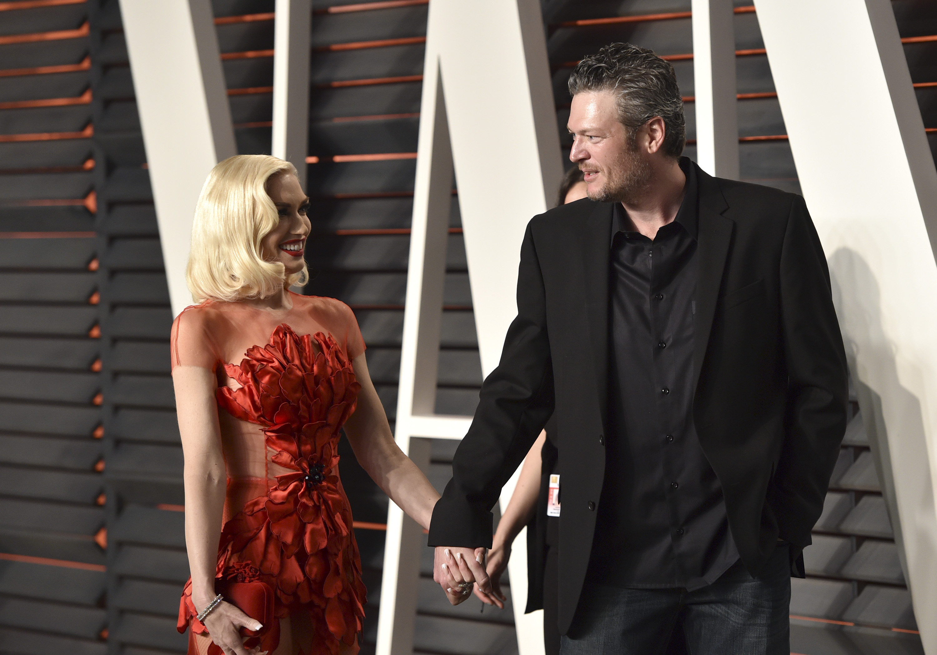 Recording artists Gwen Stefani (L) and Blake Shelton arrive at the 2016 Vanity Fair Oscar Party on Feb.  28, in Beverly Hills, California.