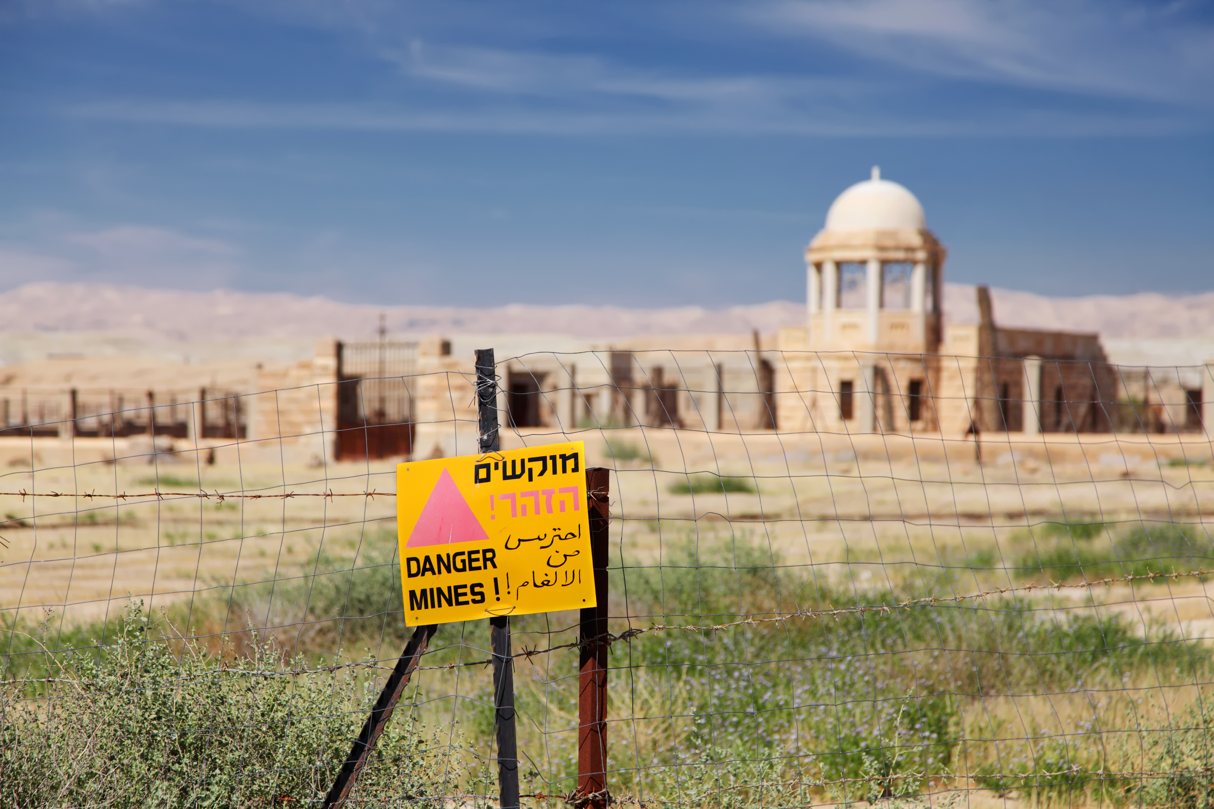 A danger sign on a fence at the Qasr-el-Yahud site.