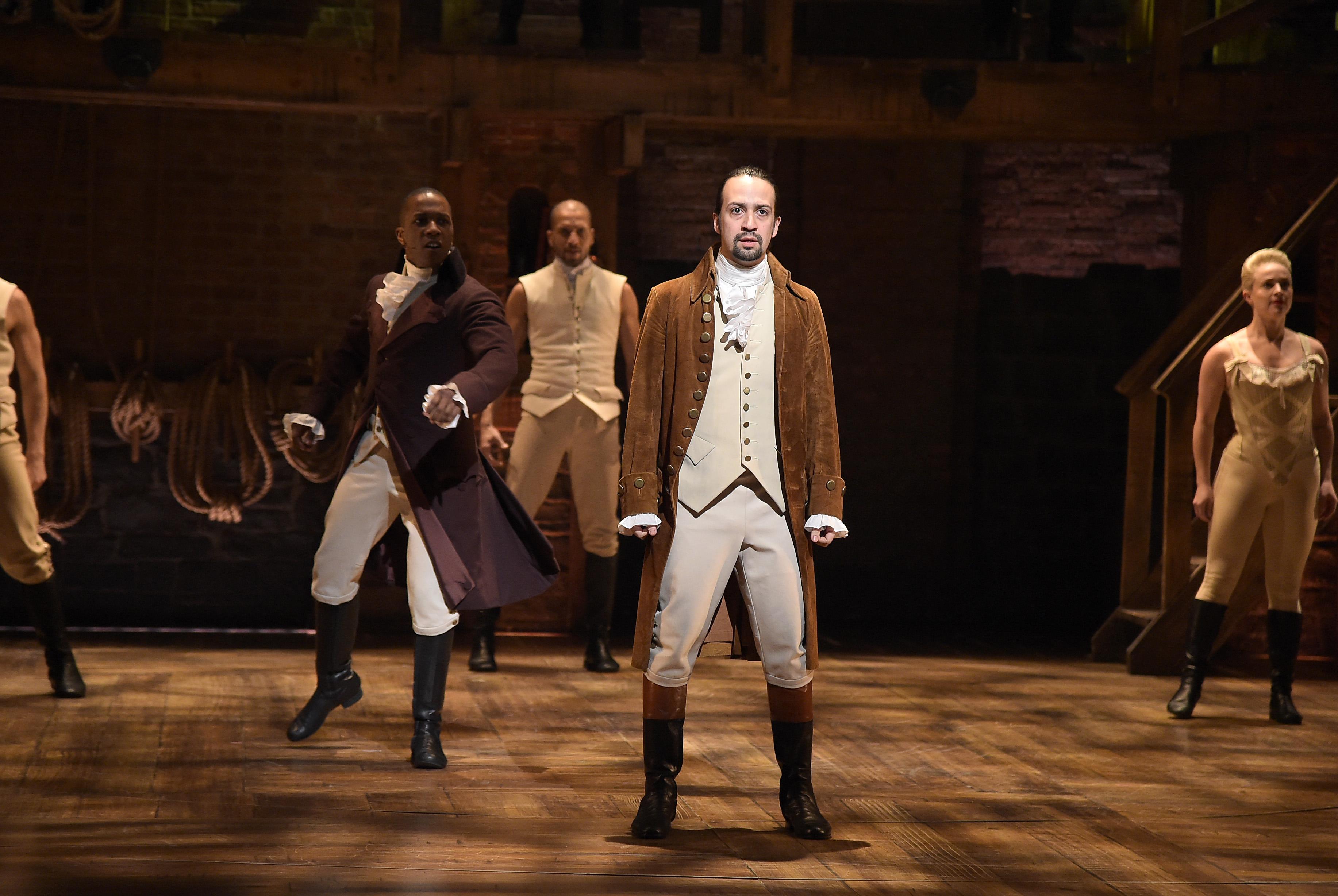Actor Leslie Odom, Jr. (L)  and actor, composer Lin-Manuel Miranda (R) perform on stage during  Hamilton.