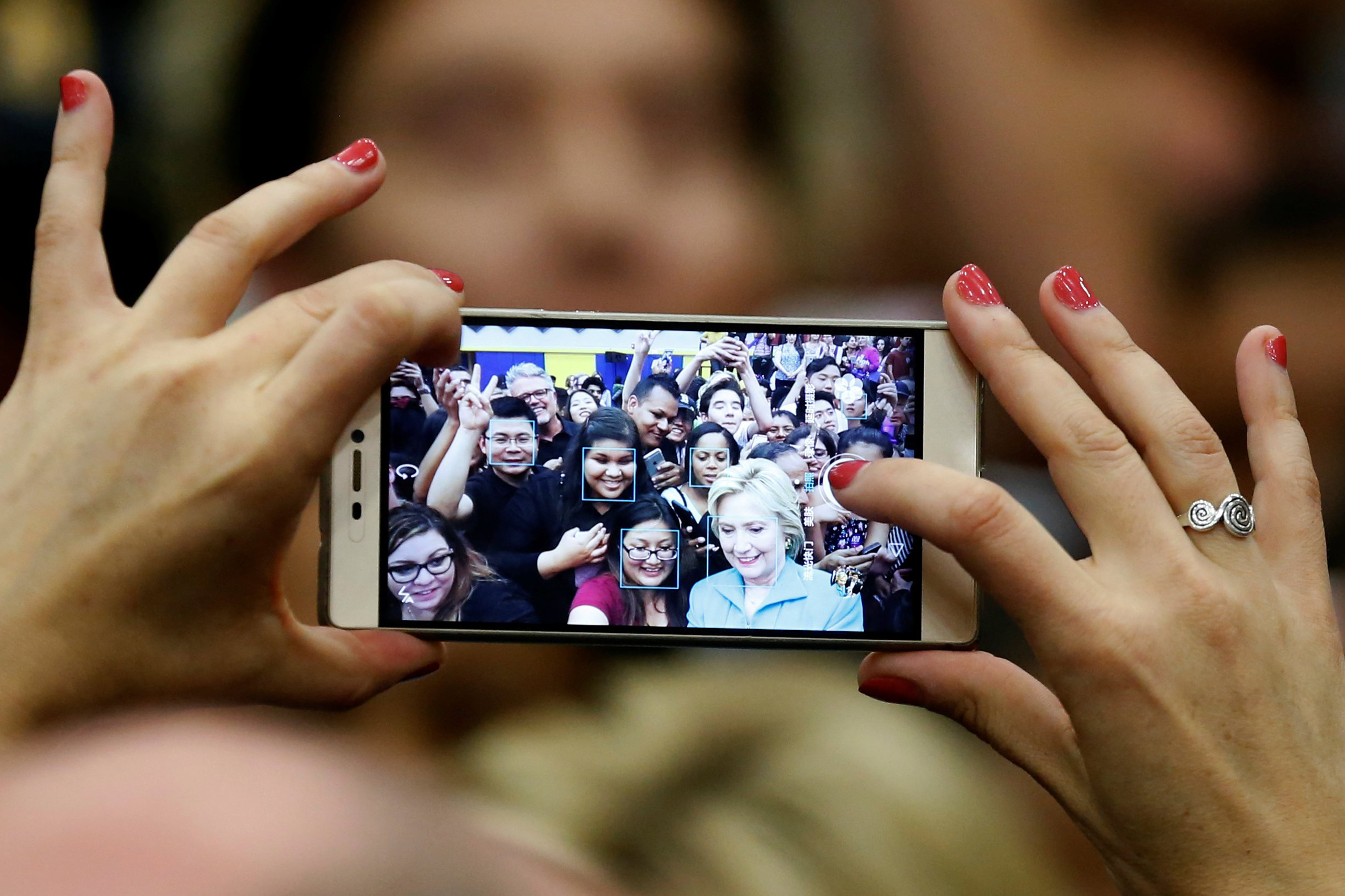 Democratic presidential candidate Hillary Clinton takes a selfie with supporters after speaking at the University of California Riverside in Riverside, Calif., on May 24, 2016.