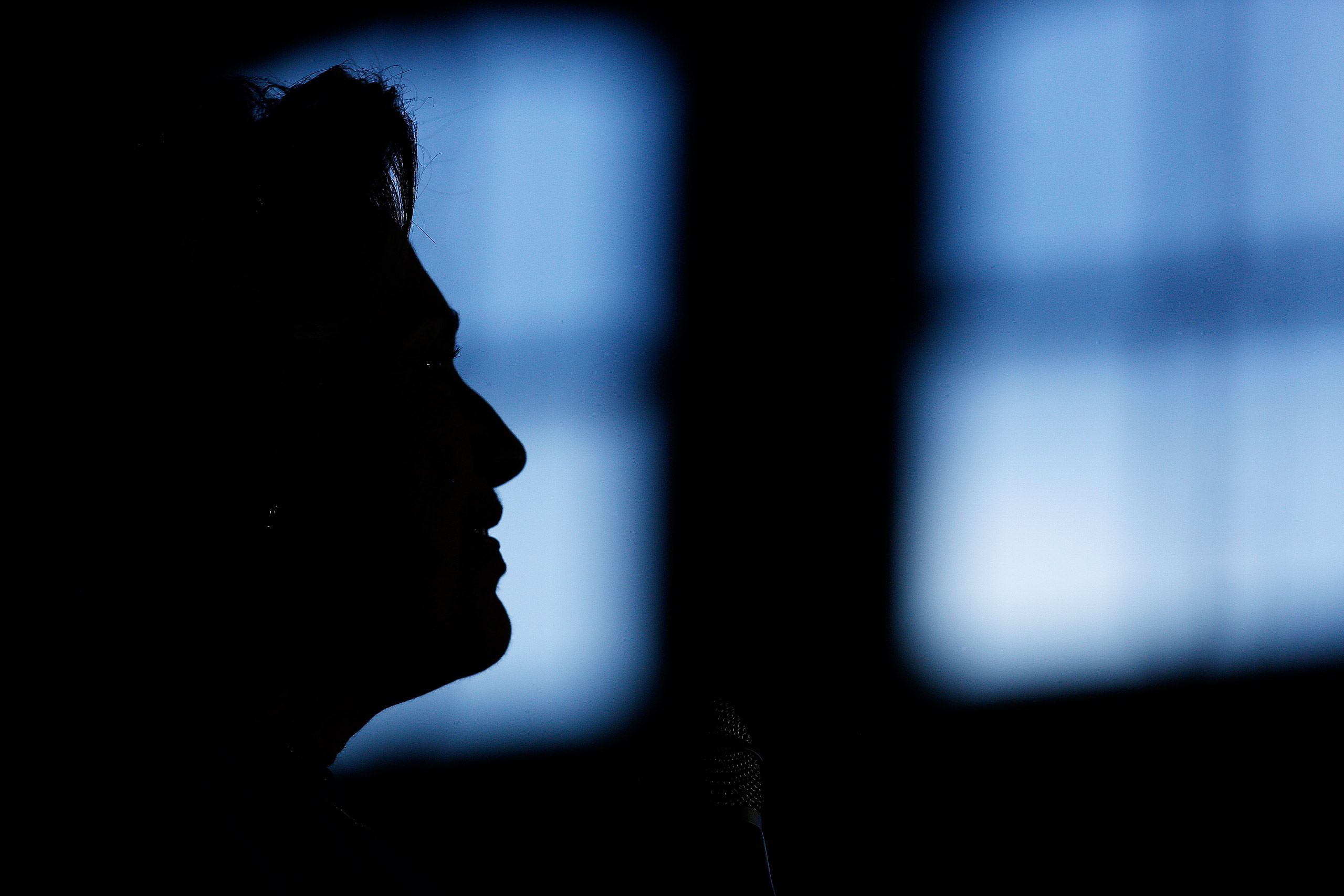 The silhouette of Hillary Clinton, former Secretary of State and 2016 Democratic presidential candidate, is seen during a campaign event in Louisville, Ky., on May 10, 2016.
