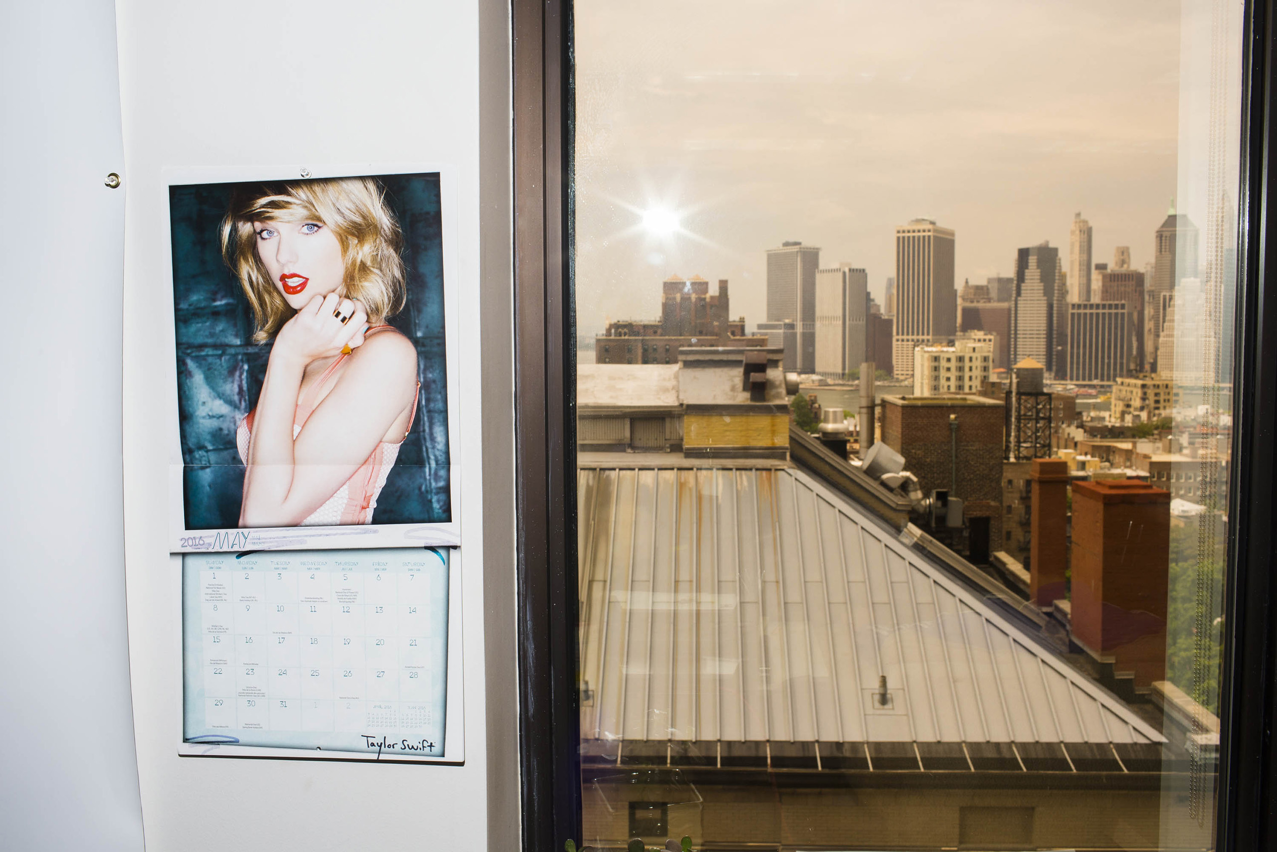 A Taylor Swift calendar hangs Inside the campaign headquarters of Hillary Clinton on May 24, 2016, in Brooklyn, NY.