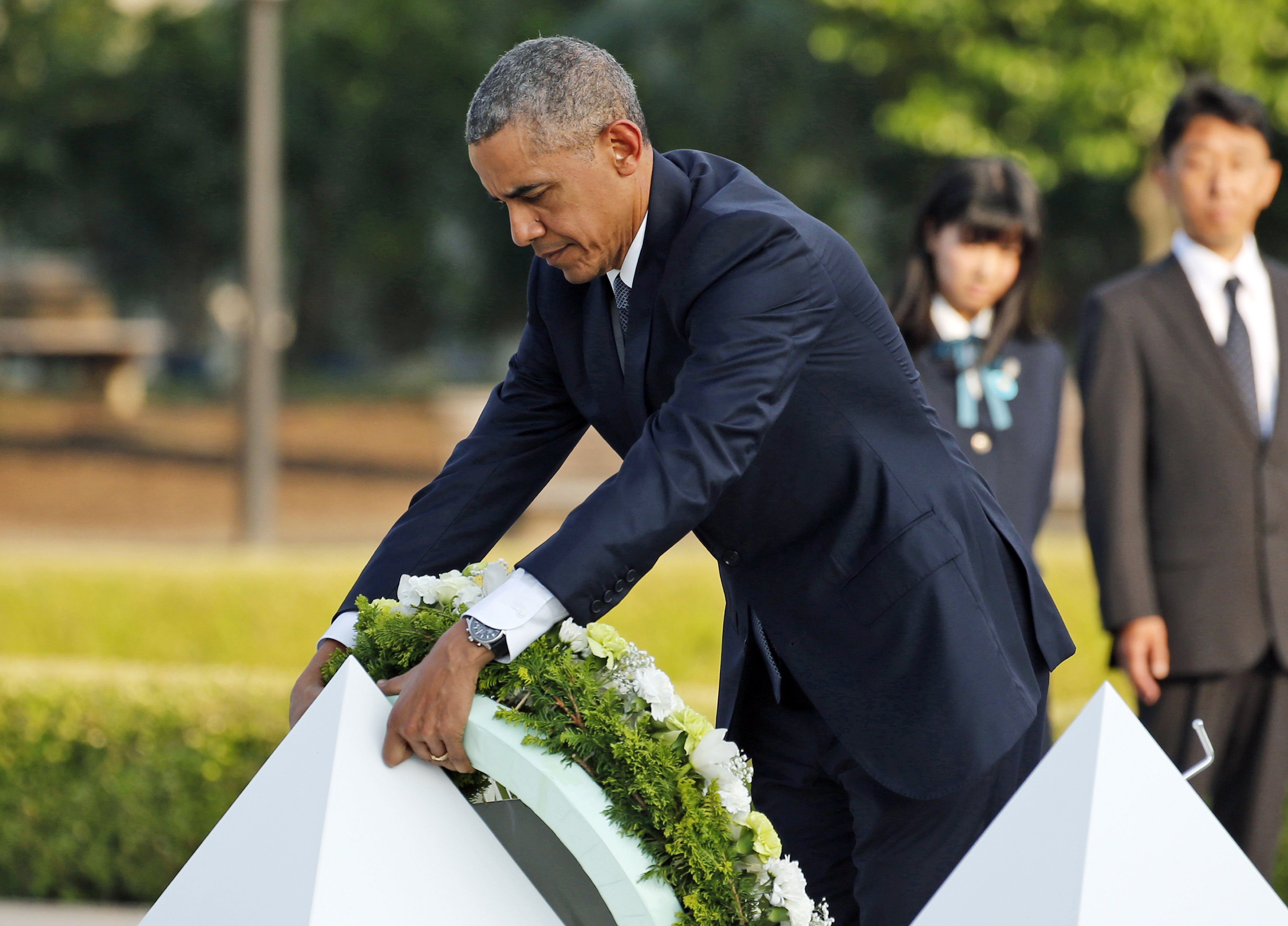 U.S. President Barack Obama lays wreaths at the cenotaph at Hiroshima Peace Memorial Park in Hiroshima, western Japan, Friday, May 27, 2016.
