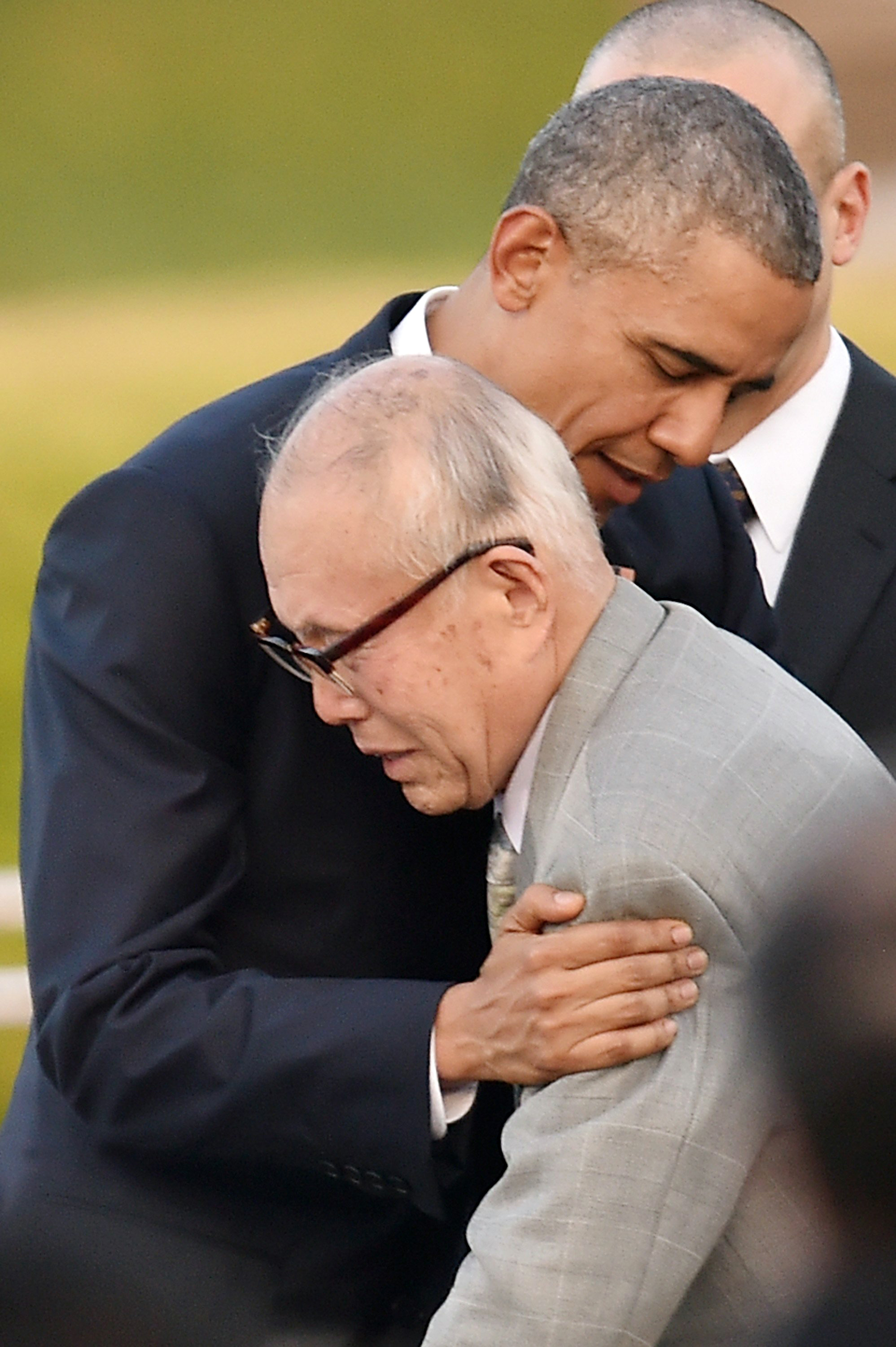 U.S. President Barack Obama embraces atomic bomb survivor Shigeaki Mori during his visit to the Hiroshima Peace Memorial Park on May 27, 2016 in Hiroshima, Japan.