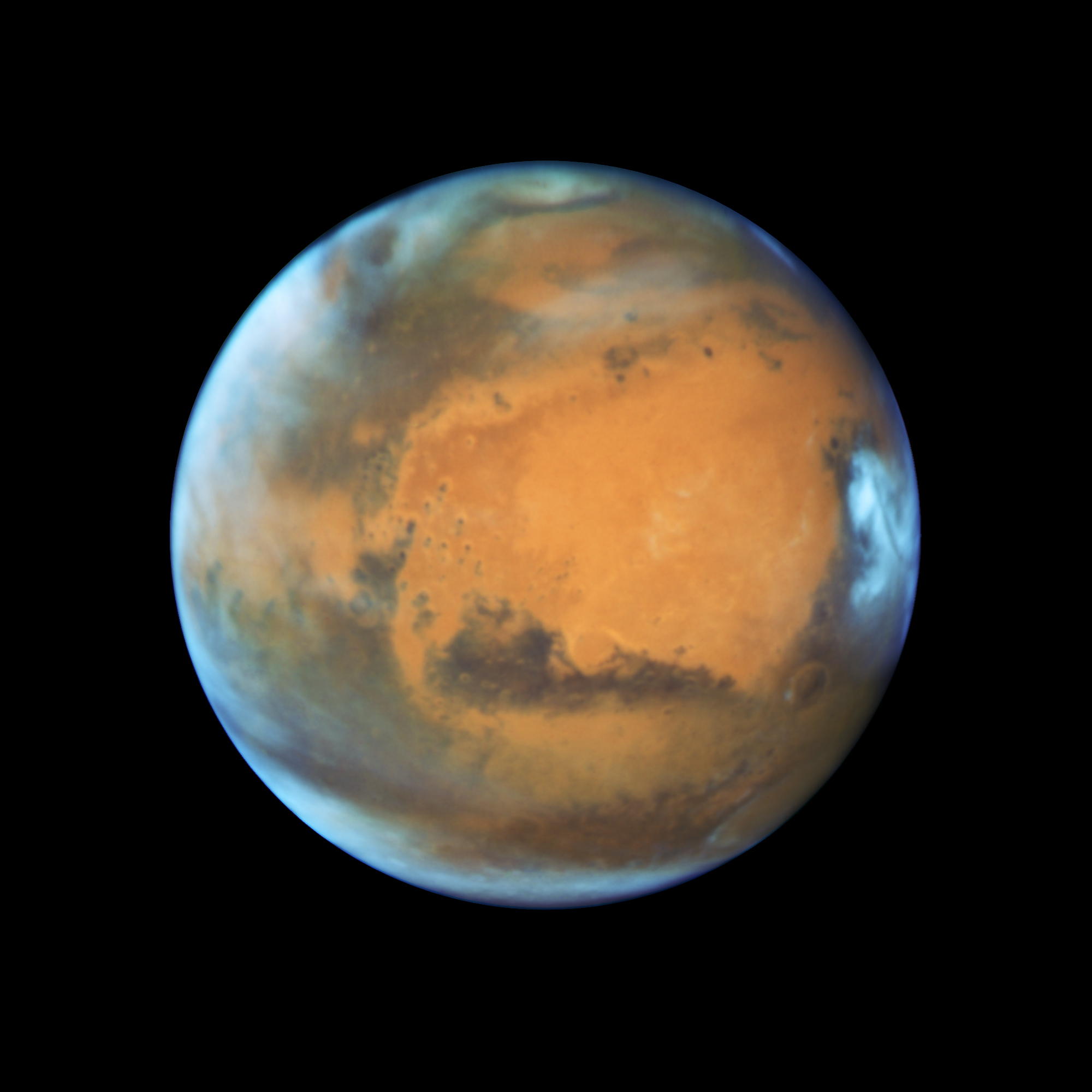 Bright, frosty polar caps, and clouds above a vivid, rust-colored landscape reveal Mars as a dynamic seasonal planet on May 12, 2016.