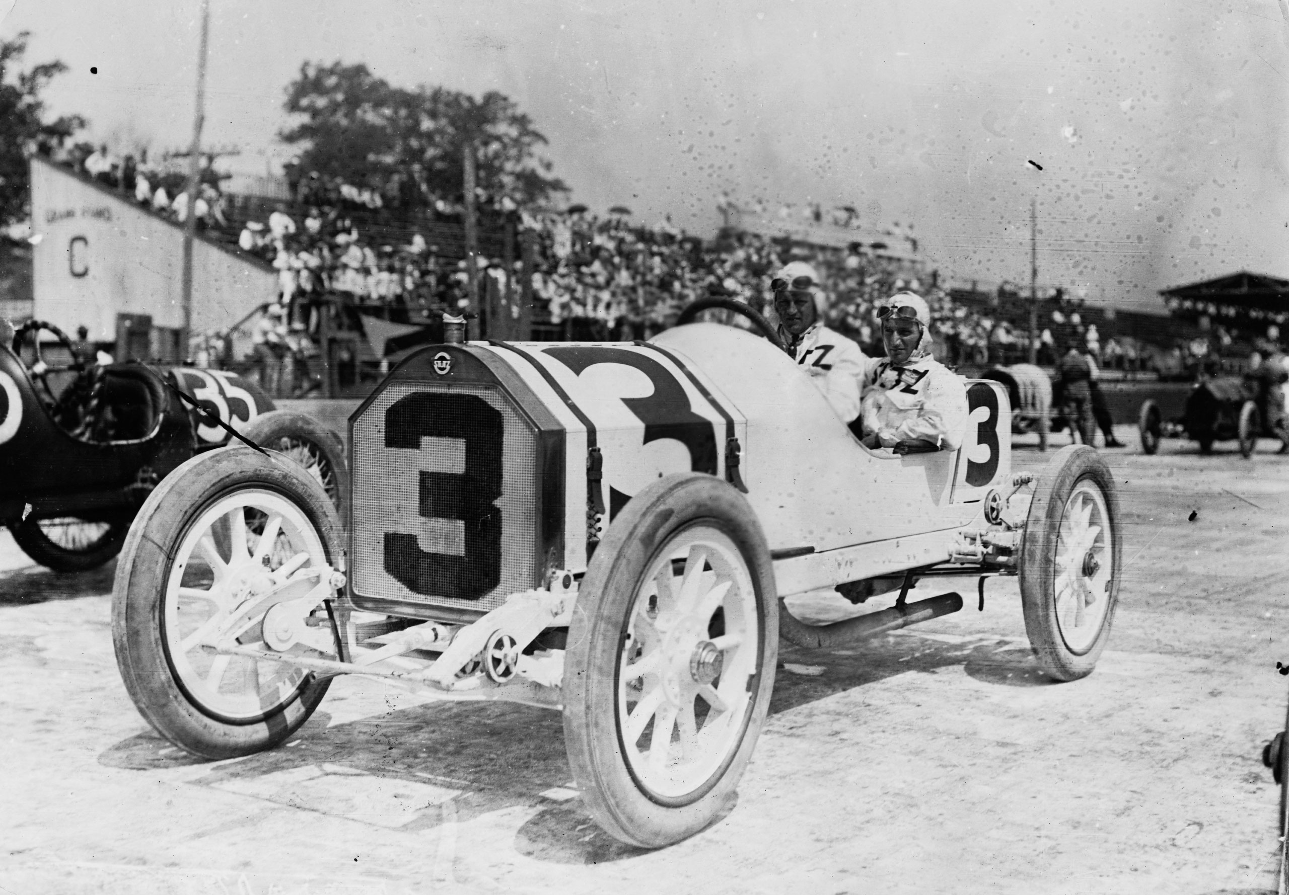 Gil Andersen of Norway with his riding mechanic aboard the #3 Stutz Motor Company Stutz Bearcat racer before the start of the third running of the Indianapolis 500 Mile Race on May 30, 1913 at the Indianapolis Motor Speedway.