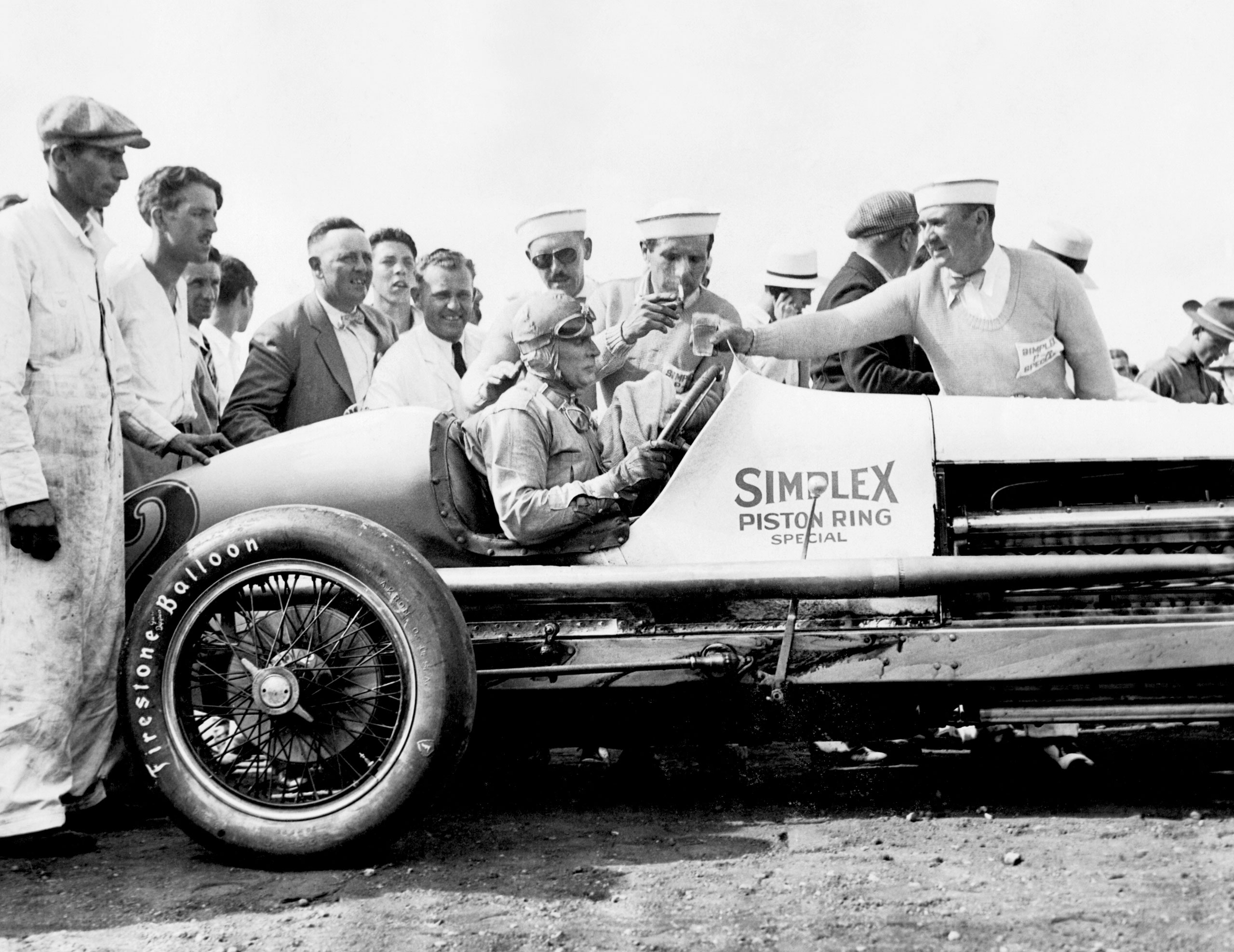 Race car driver Ray Keech in his Simplex Piston Ring Special #2 race car after winning the Indy 500. Indianapolis, Indiana, 1929.