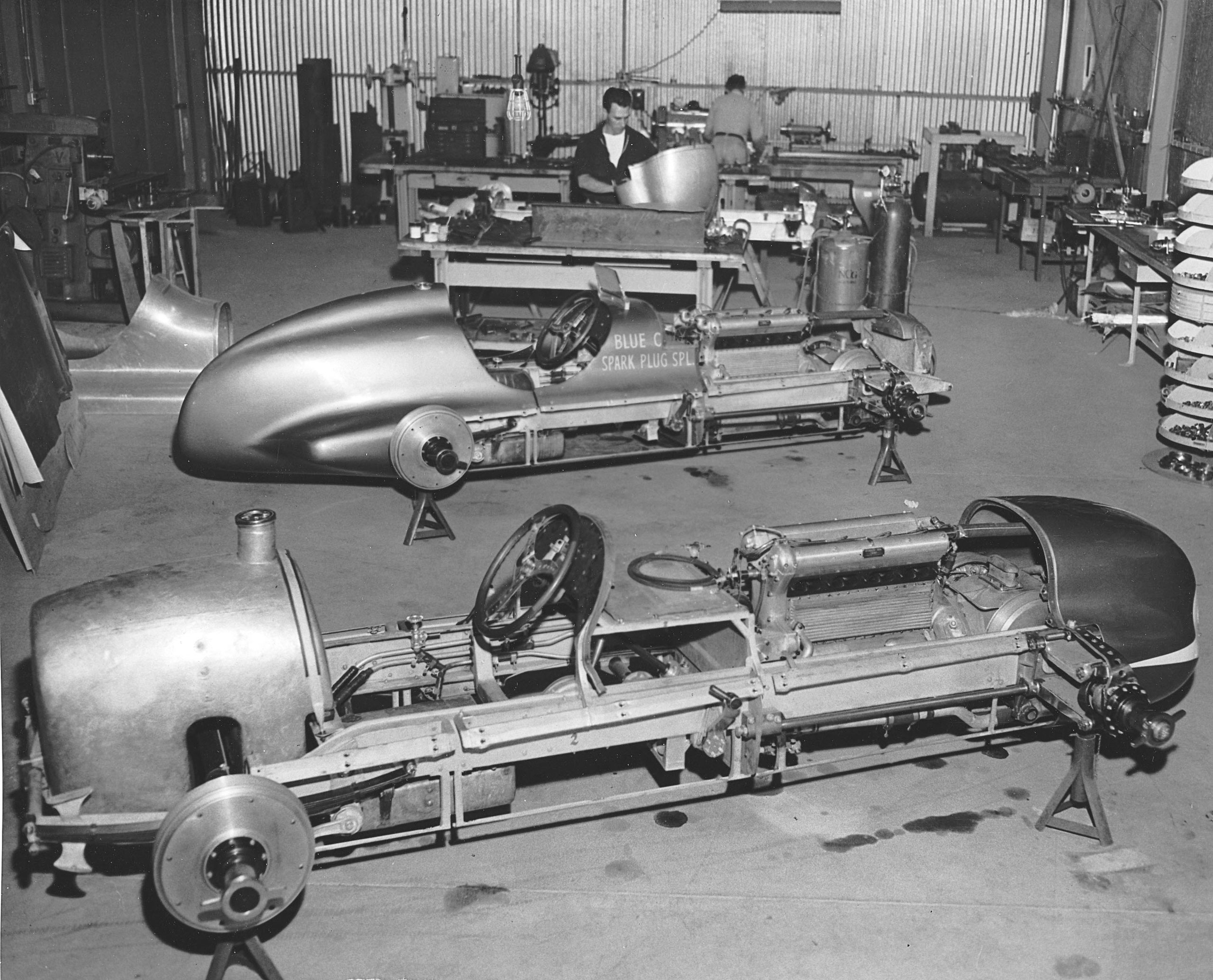 1947: The two Blue Crown Spark Plug Specials owned by former driver Lou Moore are shown being prepared for the running of the Indianapolis 500 race at the Indianapolis Motor Speedway.  The Deidt chassis, Offenhauser-powered machines were piloted to a one-two finish in the Indy 500 by Mauri Rose and Bill Holland.
