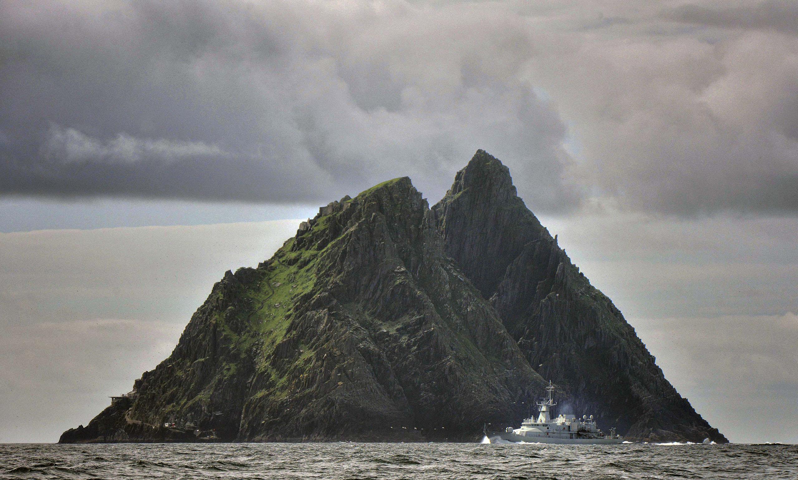 An Irish navy ship patrols around Skellig Island, Ireland, where Star Wars Episode VII was filmed, July 28, 2014.