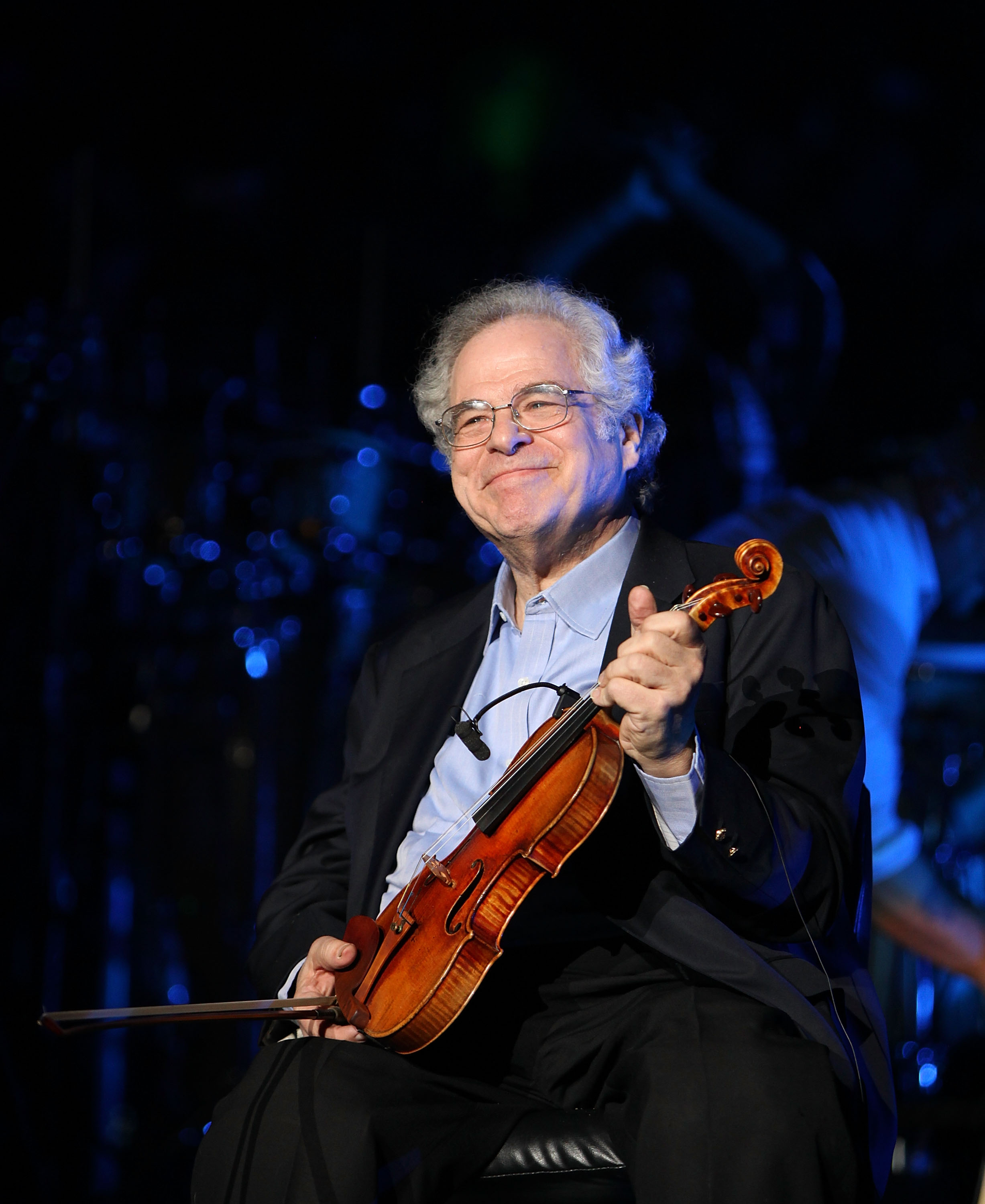 Violinist virtuoso Itzhak Perlman performs at  Billy Joel's sold out concert at Madison Square Garden on March 9, 2015 in New York City.