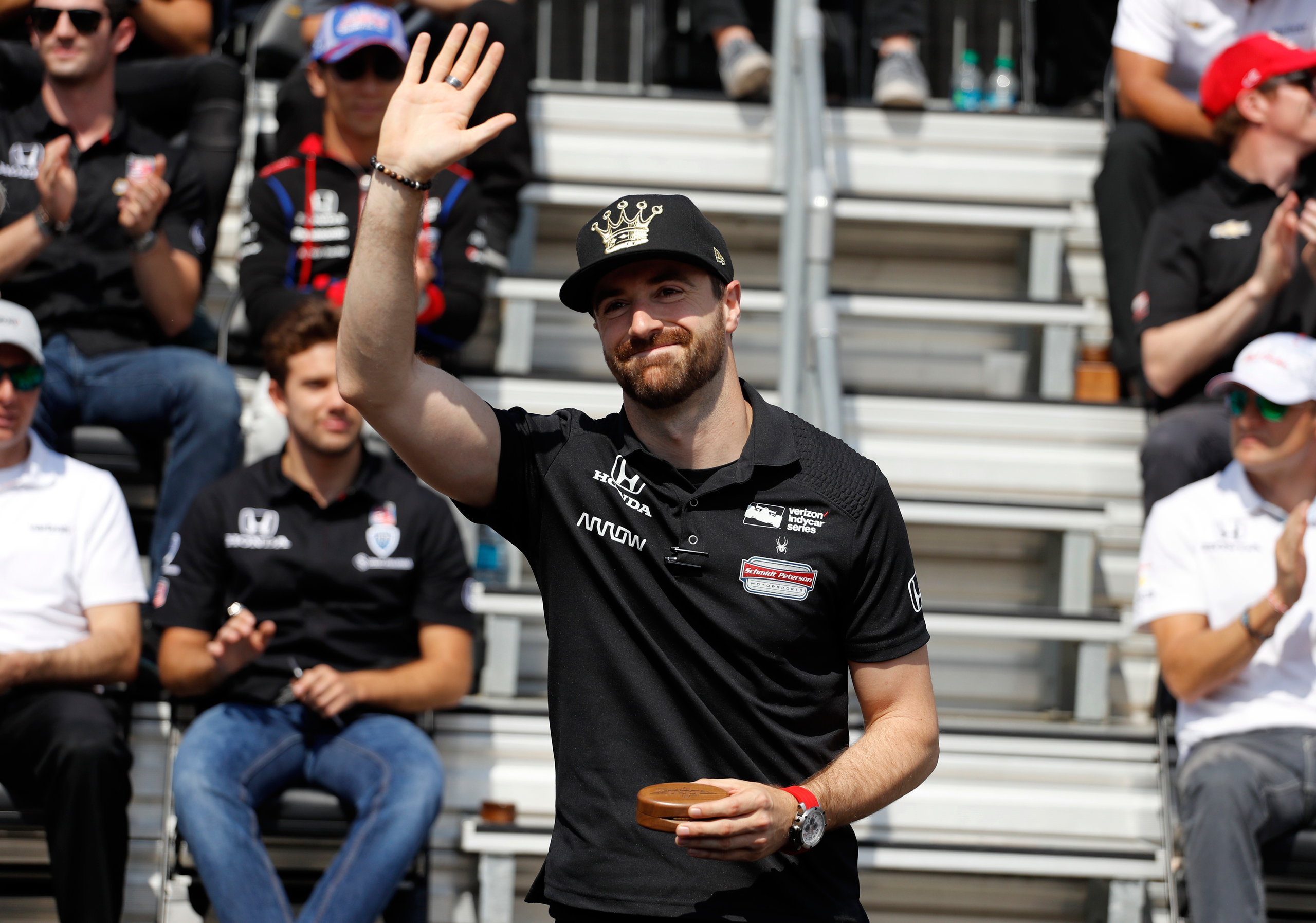 Pole sitter James Hinchcliffe, of Canada, waves to fans during the drivers meeting for the Indianapolis 500 auto race at Indianapolis Motor Speedway in Indianapolis on May 28, 2016.
