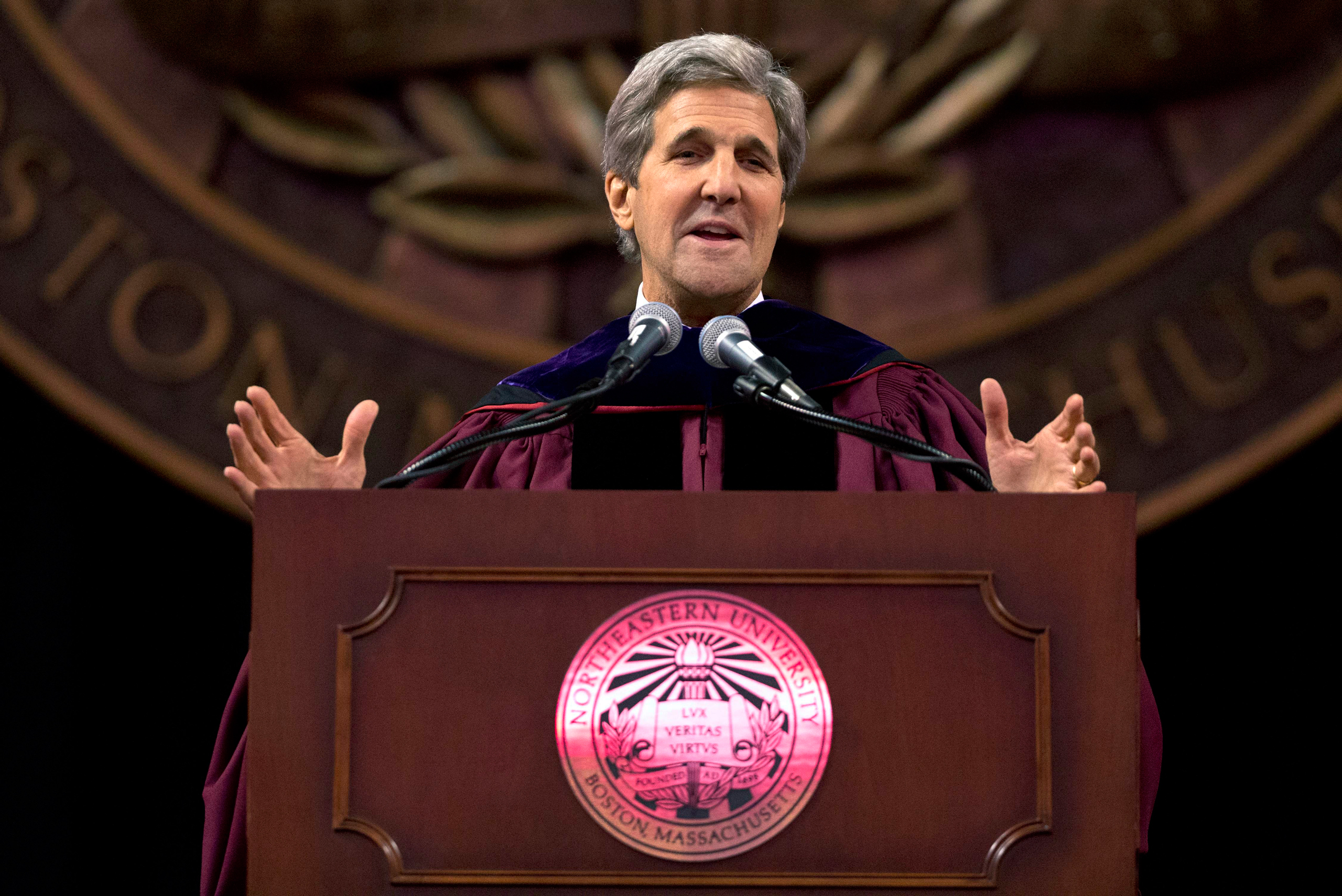 Secretary of State John Kerry gestures while giving the keynote address during Northeastern University's commencement ceremonies in Boston on May 6, 2016.