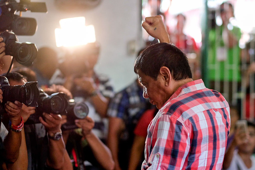 Rodrigo Duterte, Mayor of Davao and presidential candidate, gestures to members of the media at a polling station during the presidential election in Davao, Mindanao, the Philippines on May 9, 2016.