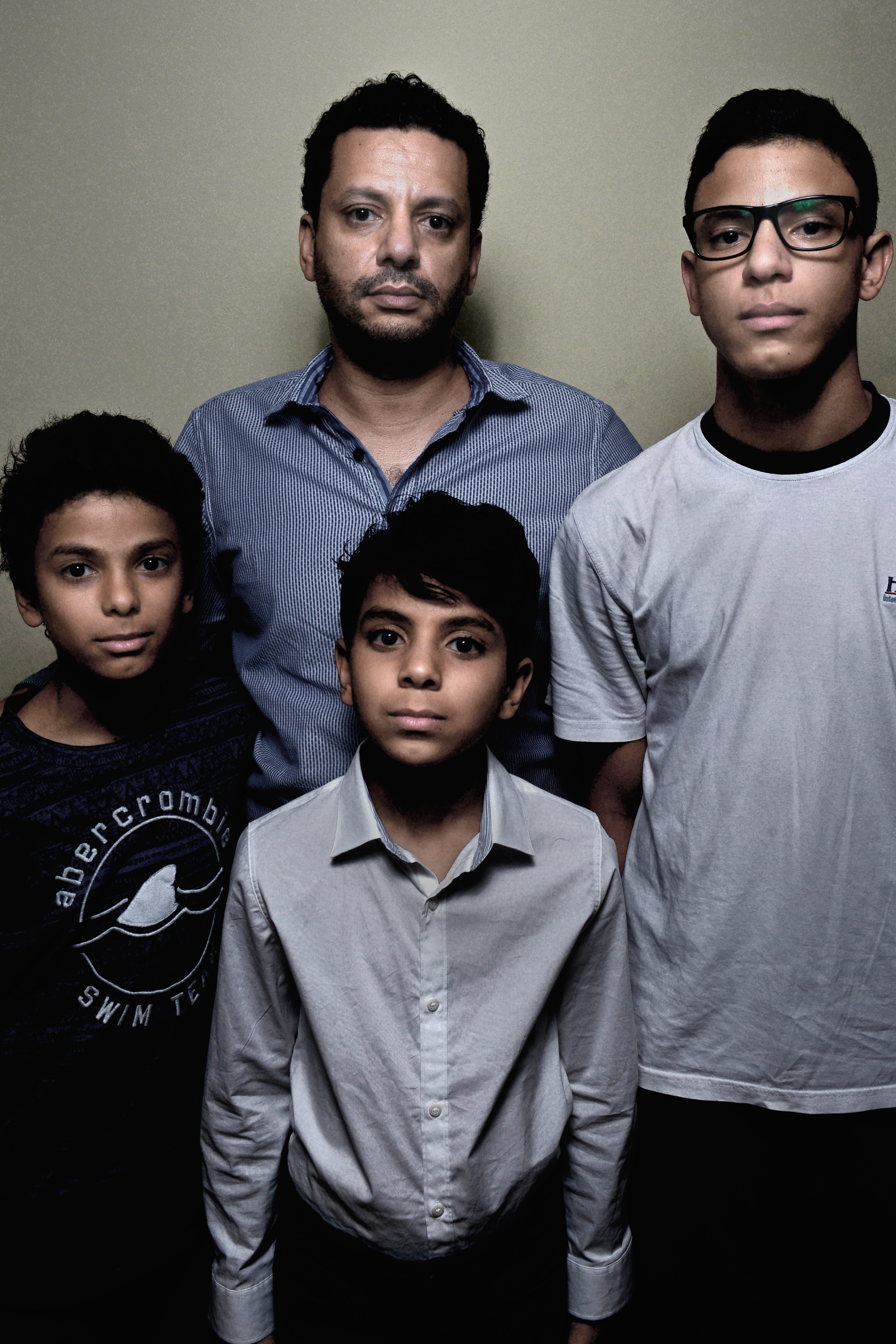 Takreem Mortada, husband of passenger Marwa Hamdy, and their children Ali, Mohamed and Ahmed