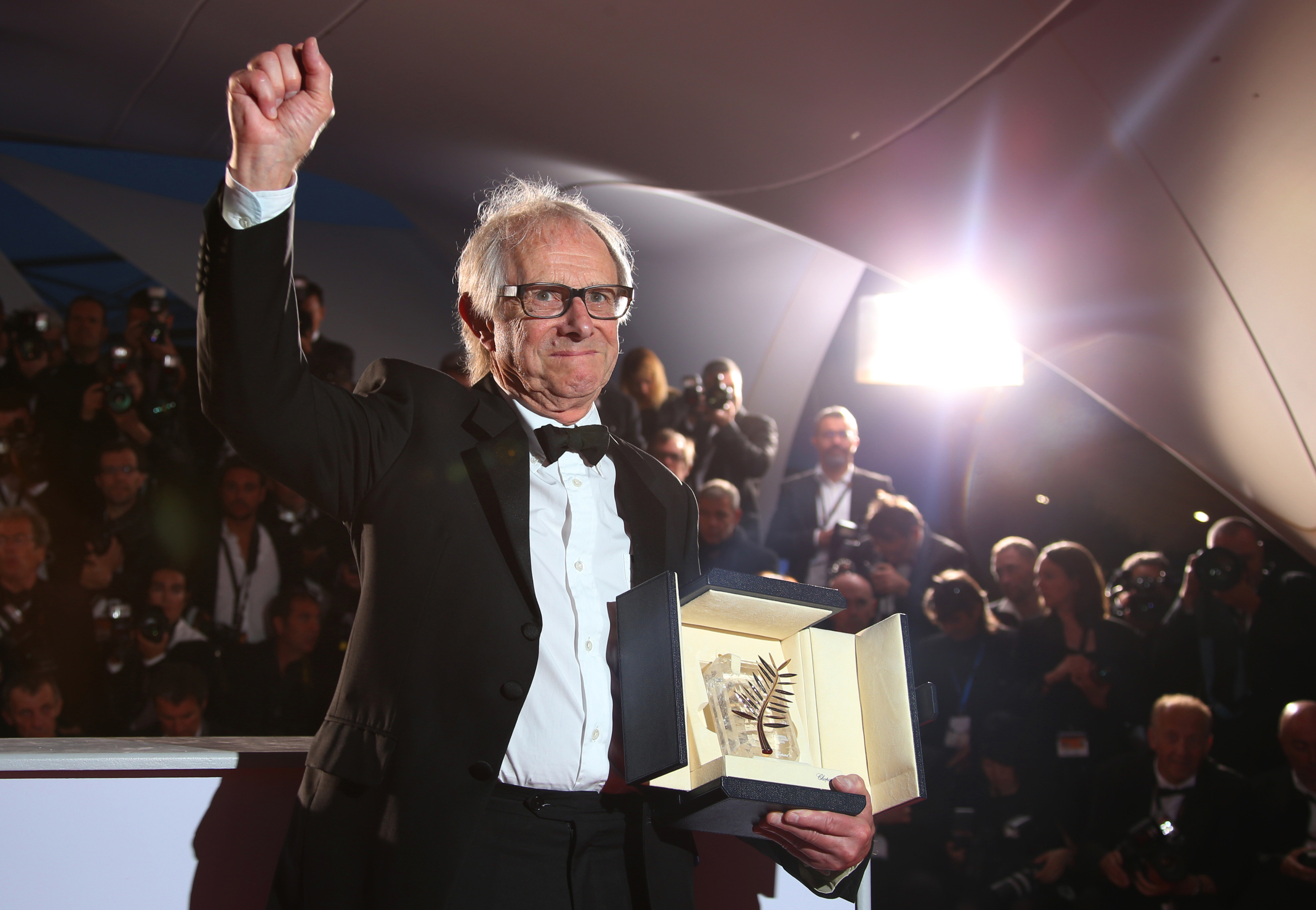 Director Ken Loach poses for photographers with the Palme d'Or for his film I, Daniel Blake during the photo call following the awards ceremony at the 69th international film festival, Cannes, France, on May 22, 2016.