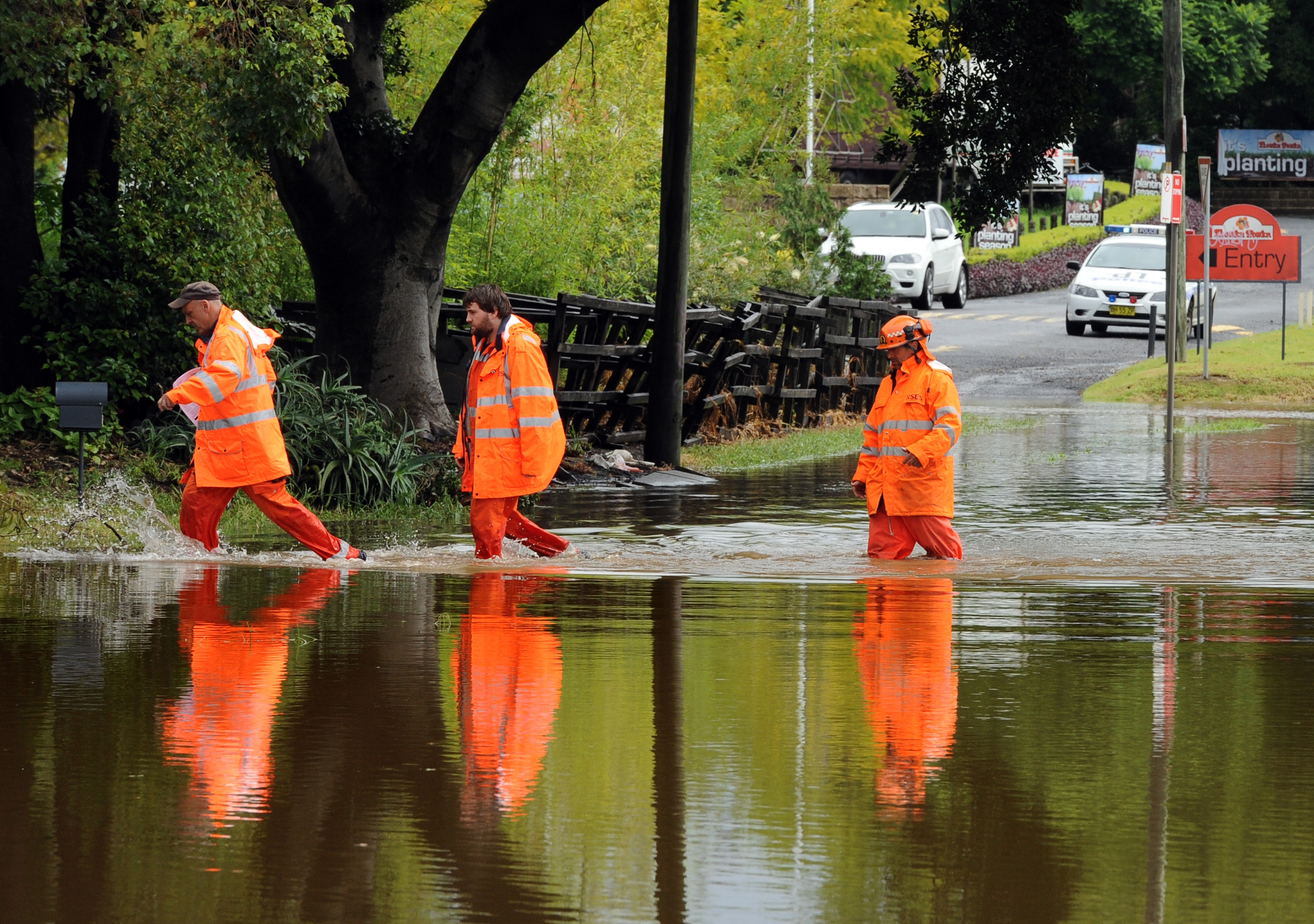 Emergency personnel check homes for inundation after heavy rains caused flash flooding across Sydney on March 8, 2012. Large tracts of New South Wales state are under water, with Sydney feeling the force of a La Nina weather system as an estimated 120 millimetres of rain fell on the city -- the highest daily total since 2007.
