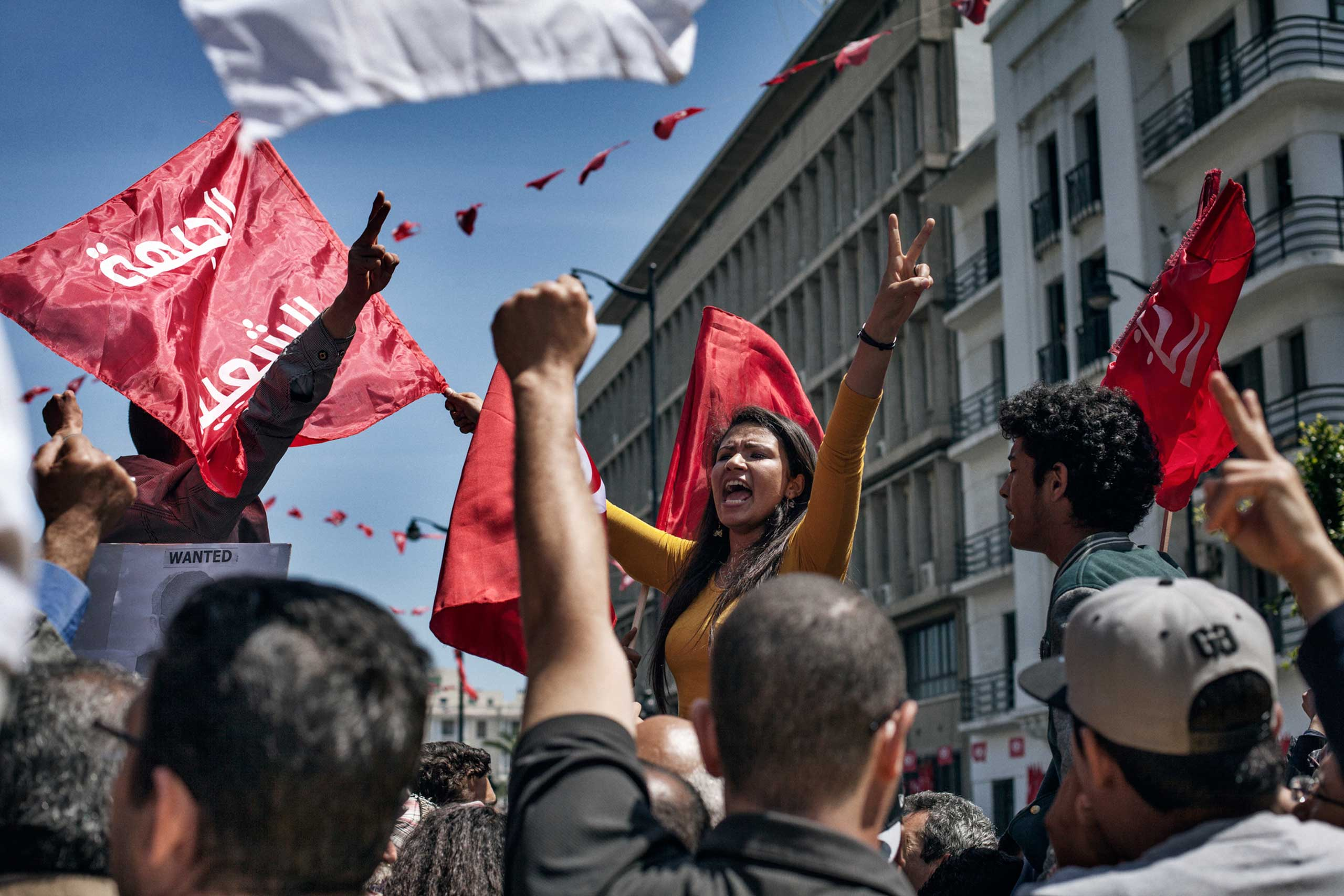 Khouloud, an engineering student, shouts slogans May 2013, during the weekly demonstration in front of the Ministry of Interior asking for progress in the investigation of the assassination of Chokri Belaid. opposition leader Chokri Belaid, was killed by a gunman in Feb. 2013.