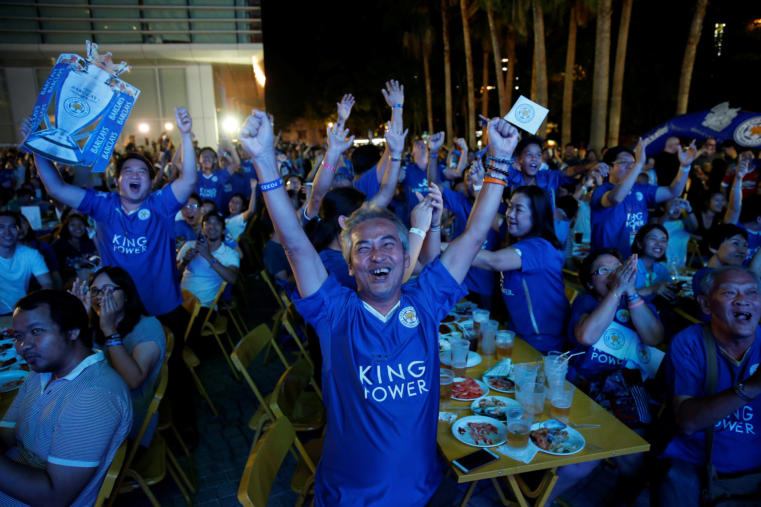 Leicester City fans celebrate after their team scores against Manchester United while watching the game on a big screen, in Bangkok, Thailand, May 1, 2016.