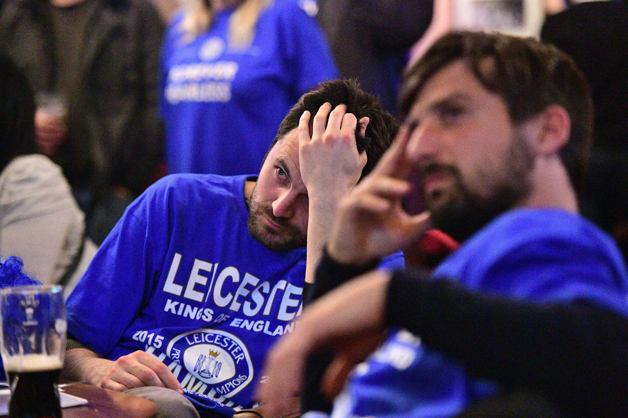 A Leicester City fan reacts as he watches after Tottenham scored their second goal in the English Premier League football match between Chelsea and Tottenham Hotspur in a pub in central Leicester, eastern England, on May 2, 2016.