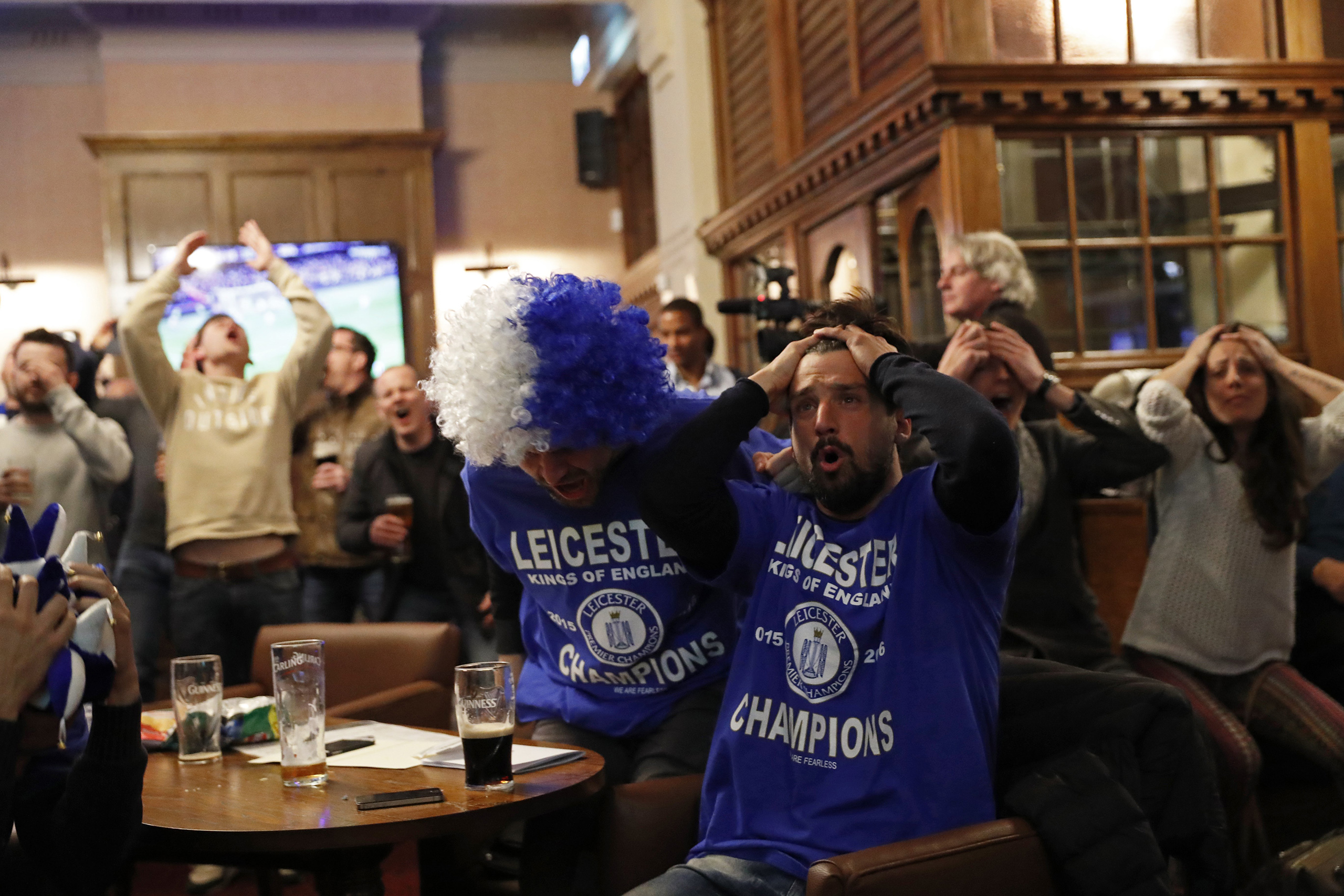 Leicester City fans watch the English Premier League match between Chelsea and Tottenham Hotspur at a pub in Leicester, eastern England, May 2, 2016.