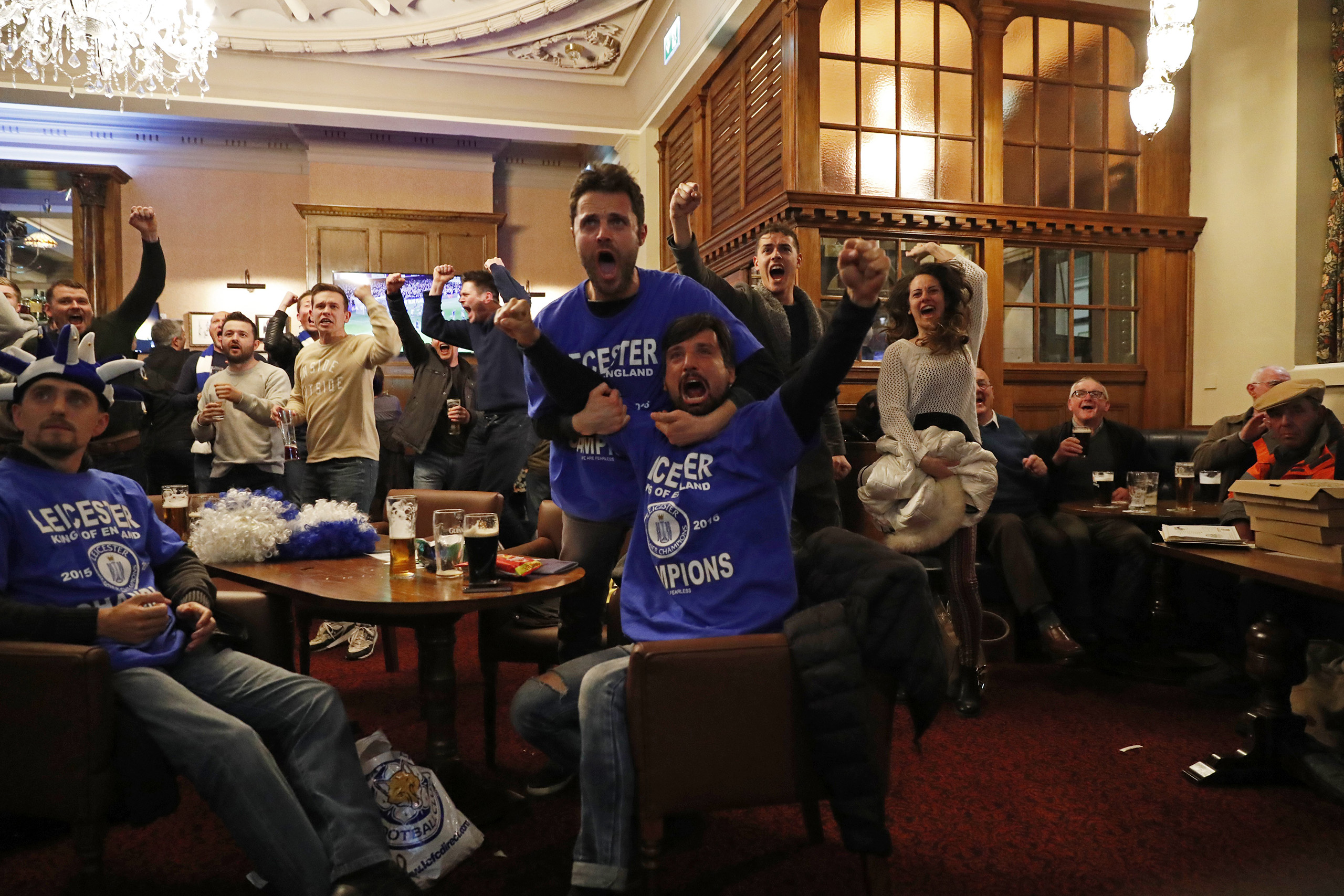 Leicester City fans celebrate after Chelsea's first goal against Tottenham Hotspur at a pub in Leicester, eastern England, May 2, 2016.