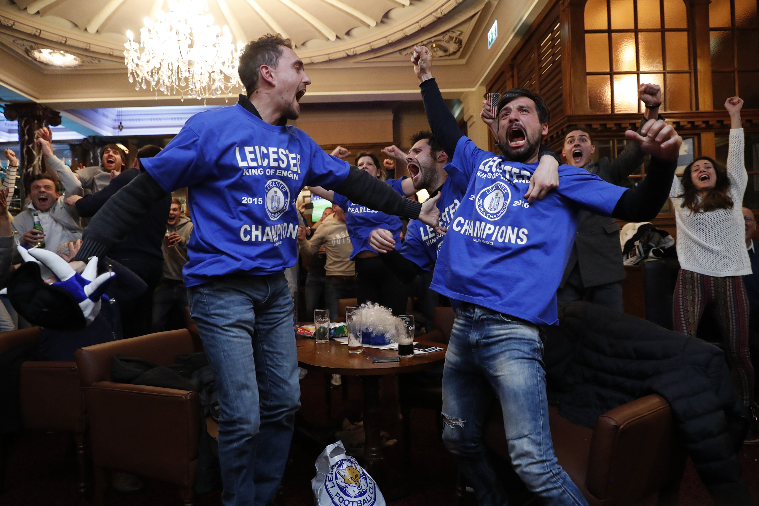 Leicester City fans celebrate after Chelsea's second goal against Tottenham Hotspur at a pub in Leicester, eastern England, May 2, 2016.