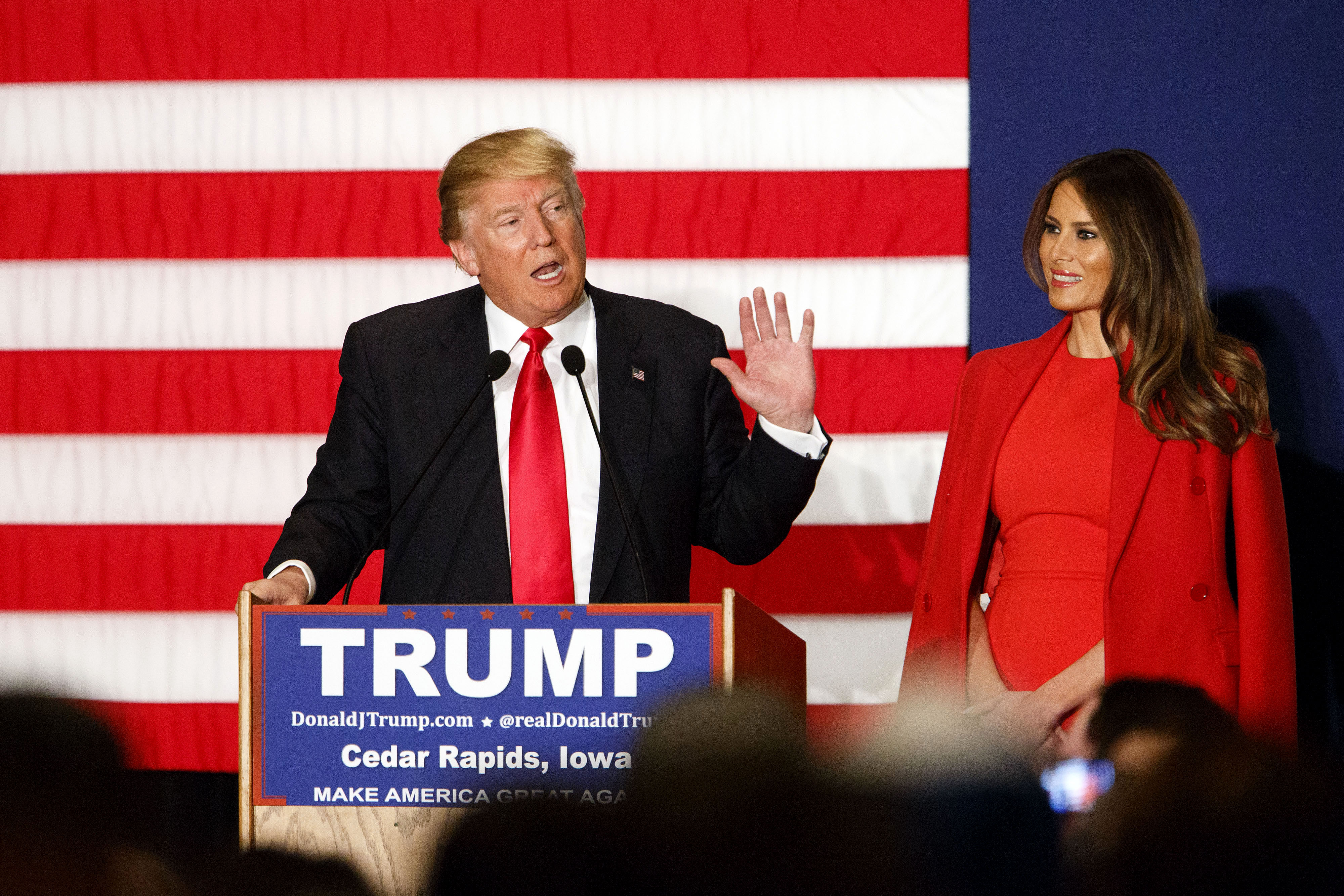 Donald Trump, president and chief executive of Trump Organization Inc. and 2016 Republican presidential candidate, left, speaks as wife Melania Trump listens during a campaign event in Cedar Rapids, Iowa, U.S., on Monday, Feb. 1, 2016.