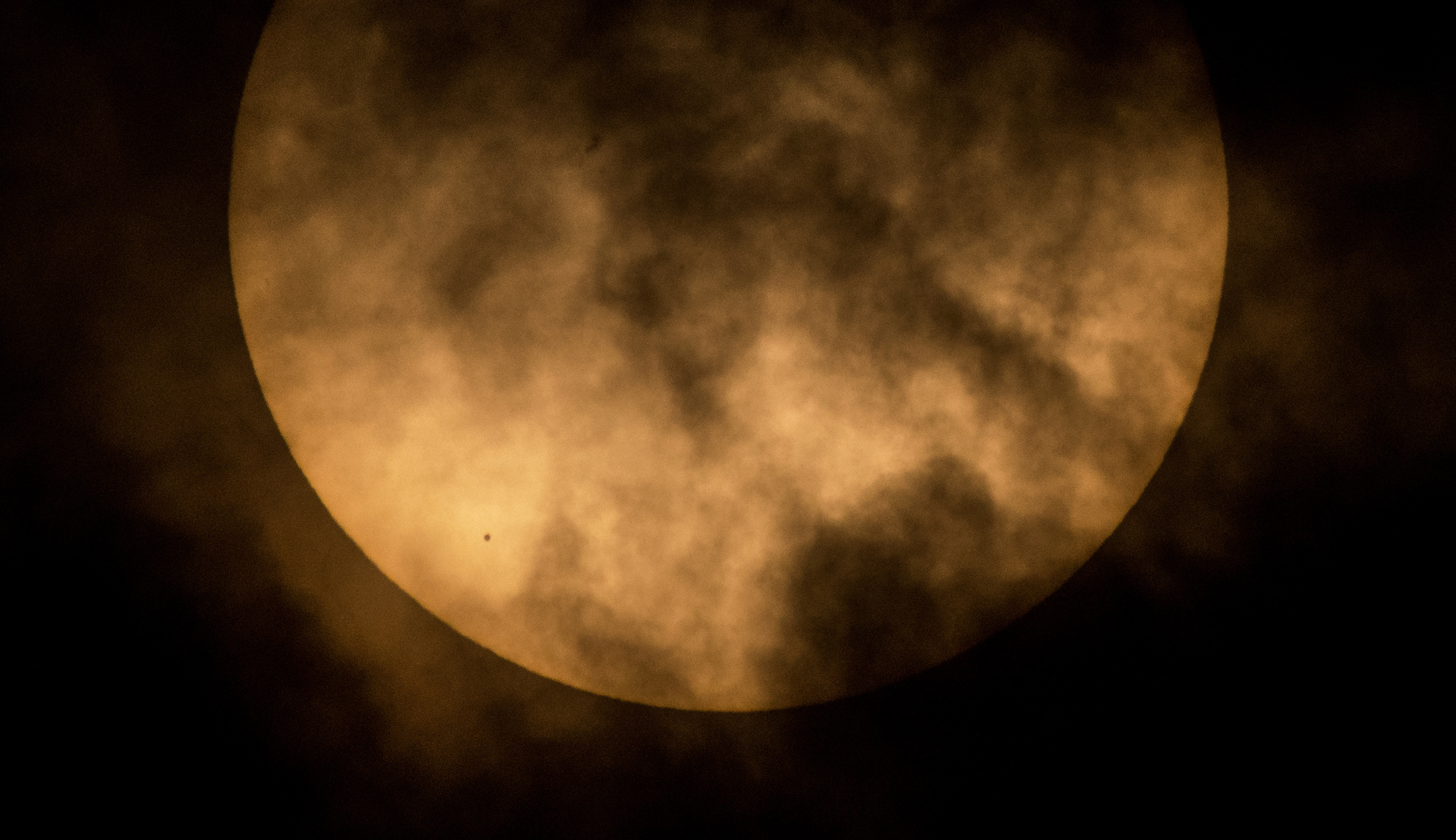 The planet Mercury is seen in silhouette, lower left, as it transits across the face of the sun in this photo taken from NASA Headquarters in Washington, DC., May 9, 2016.