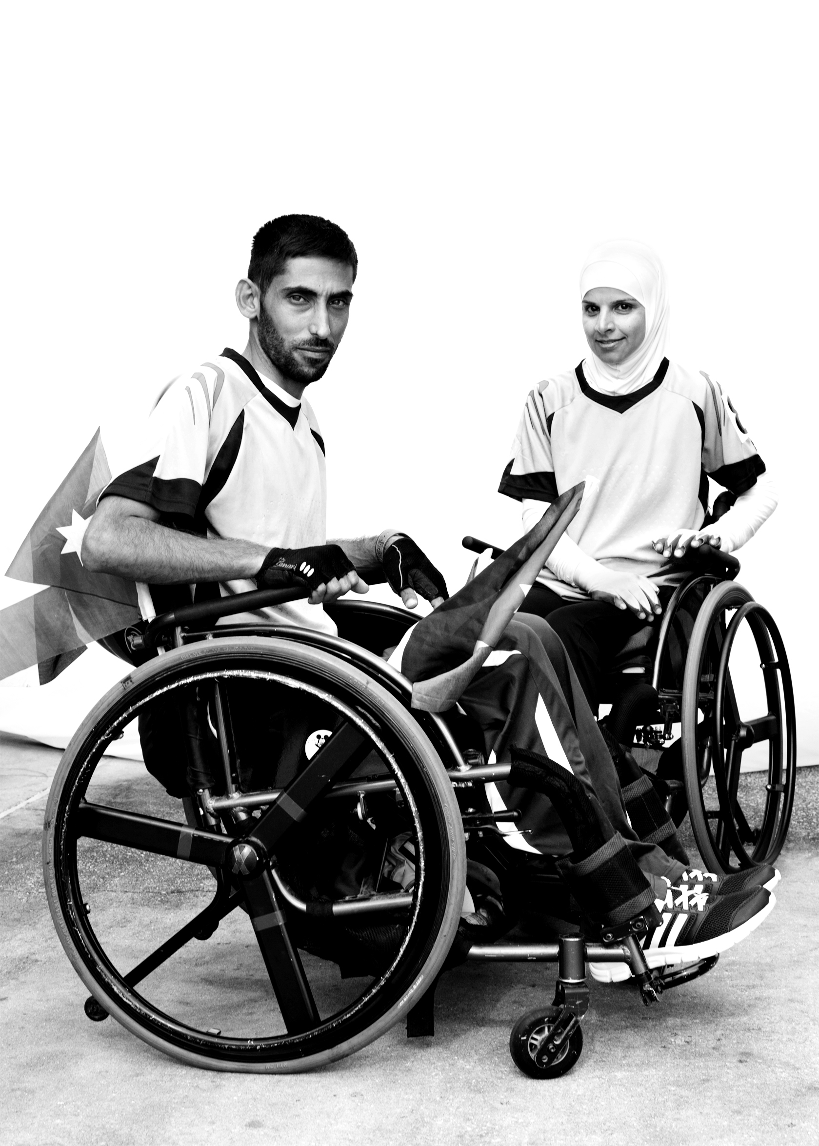 Hamzeh Qudah (left) and Ulfat Al-Zwiri (right), Jordan, competed in track