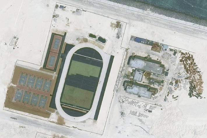 A satellite image of Mischief Reef captured on May 1, 2016, shows a running track, basketball courts and tennis courts.