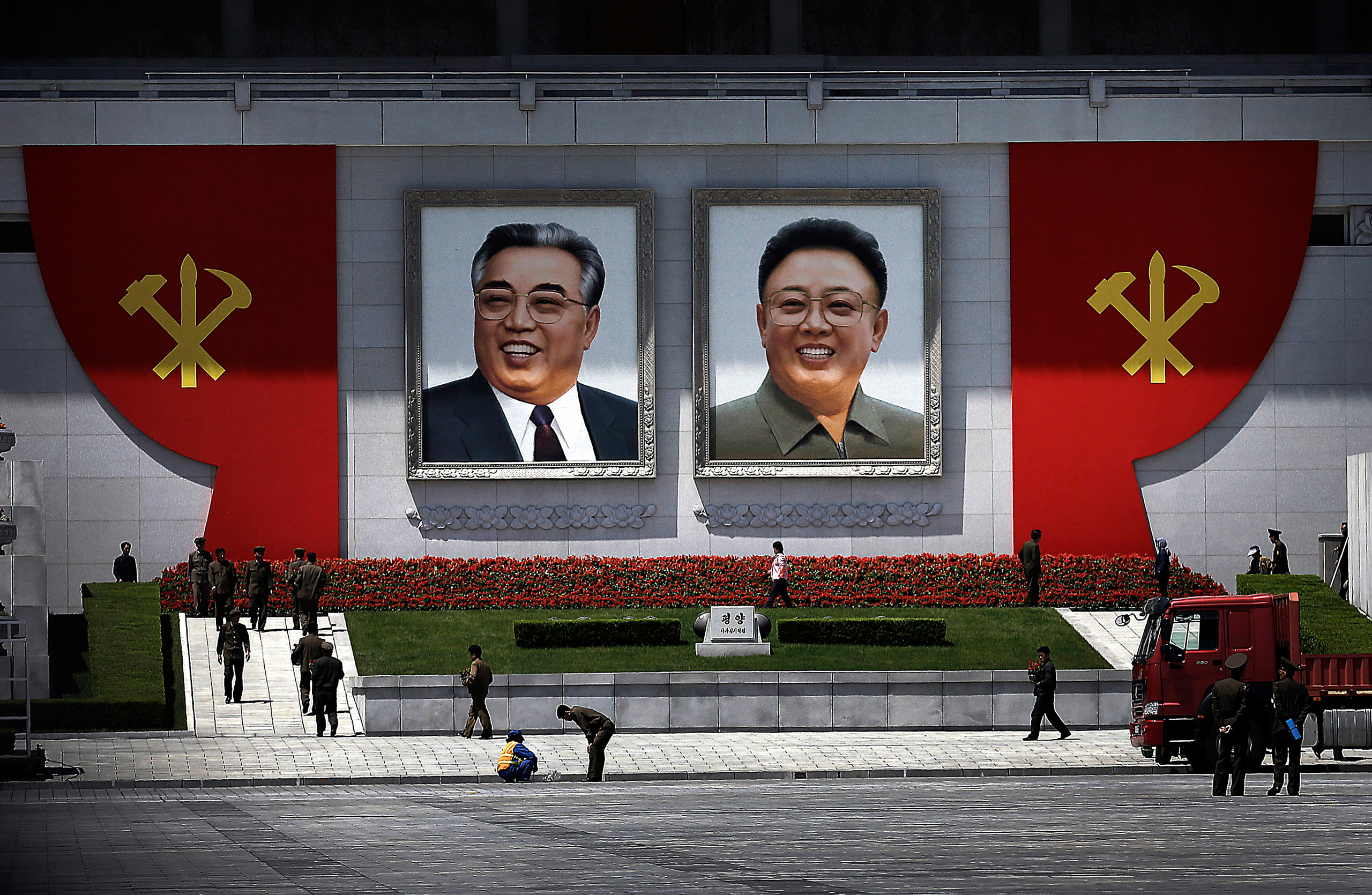 The ruling Workers' Party symbols are erected by the portraits of the late North Korean leaders Kim Il Sung, left, and Kim Jong Il while workers decorate the vicinity with flowers at the Kim Il Sung Square in Pyongyang on May 7, 2016. North Korean leader Kim Jong Un hailed his country's recent nuclear test to uproarious applause as he convened the first full congress of its ruling party since 1980, an event intended to showcase the North's stability and unity in the face of tough international sanctions and deepening isolation.
