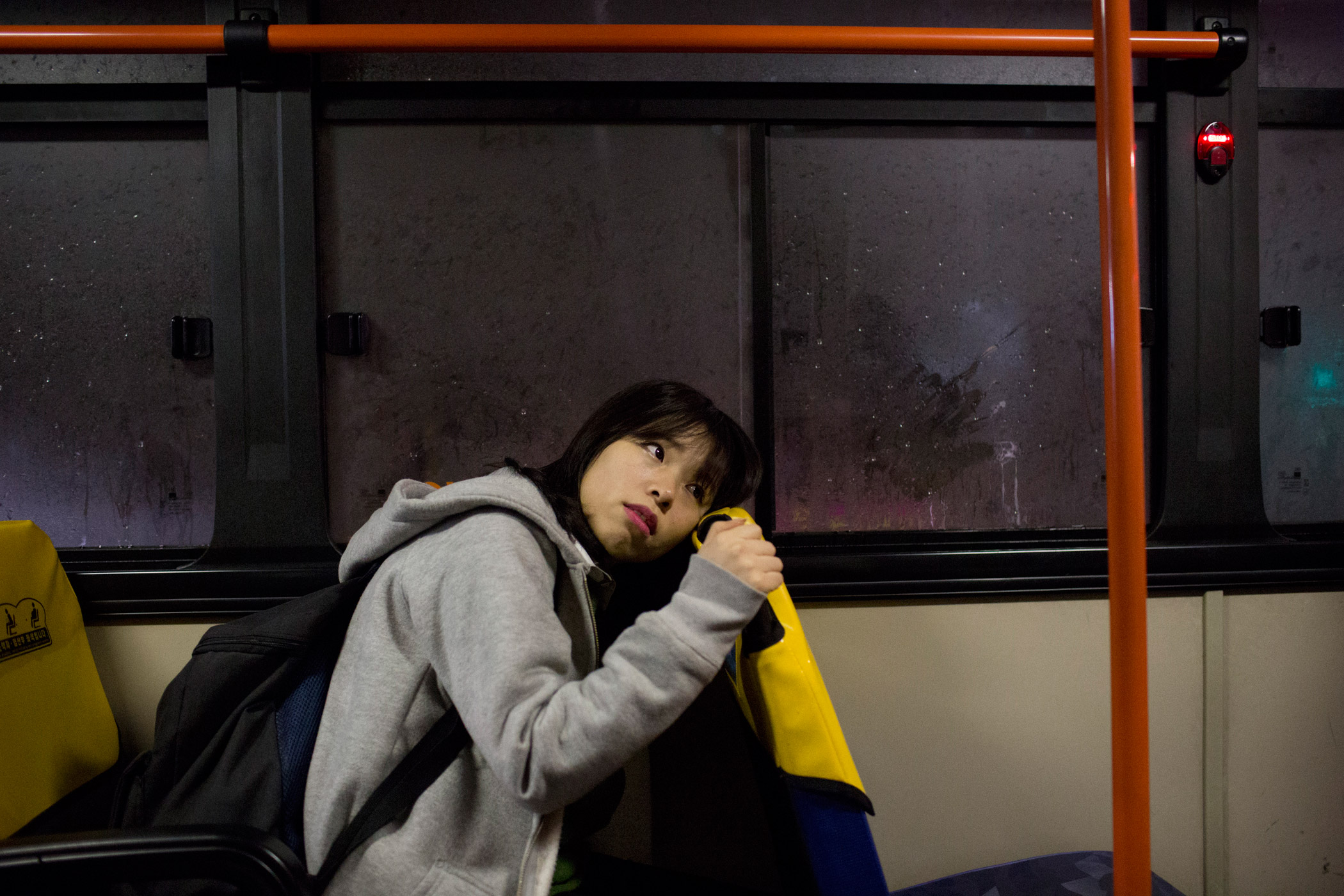 North Korean refugee Kim Kyoung-ok arrived in Seoul as a 13 year old in 2009. Here, she rides the bus home from school at 7:30 p.m. on March 4, 2015, in Seoul.