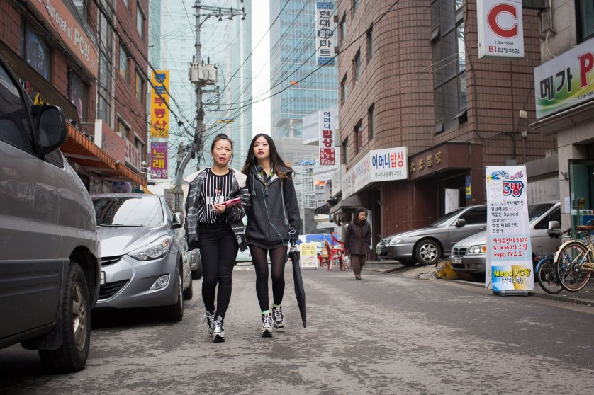 Donning matching shoes, North Korean refugees Kim Kyong-ok, 19 (Lunar age), and Sarah (English name used in order to protect source), 22, walk arm-in-arm on their way to a Christian church service on Feb. 21, 2015 near Hapjeong, Seoul, South Korea. The women met shortly after they each arrived separately in South Korea at a resettlement camp for refugees. While adjusting to life after North Korea has been challenging, their friendship is a source of strength and solidarity. Caitlin O'Hara