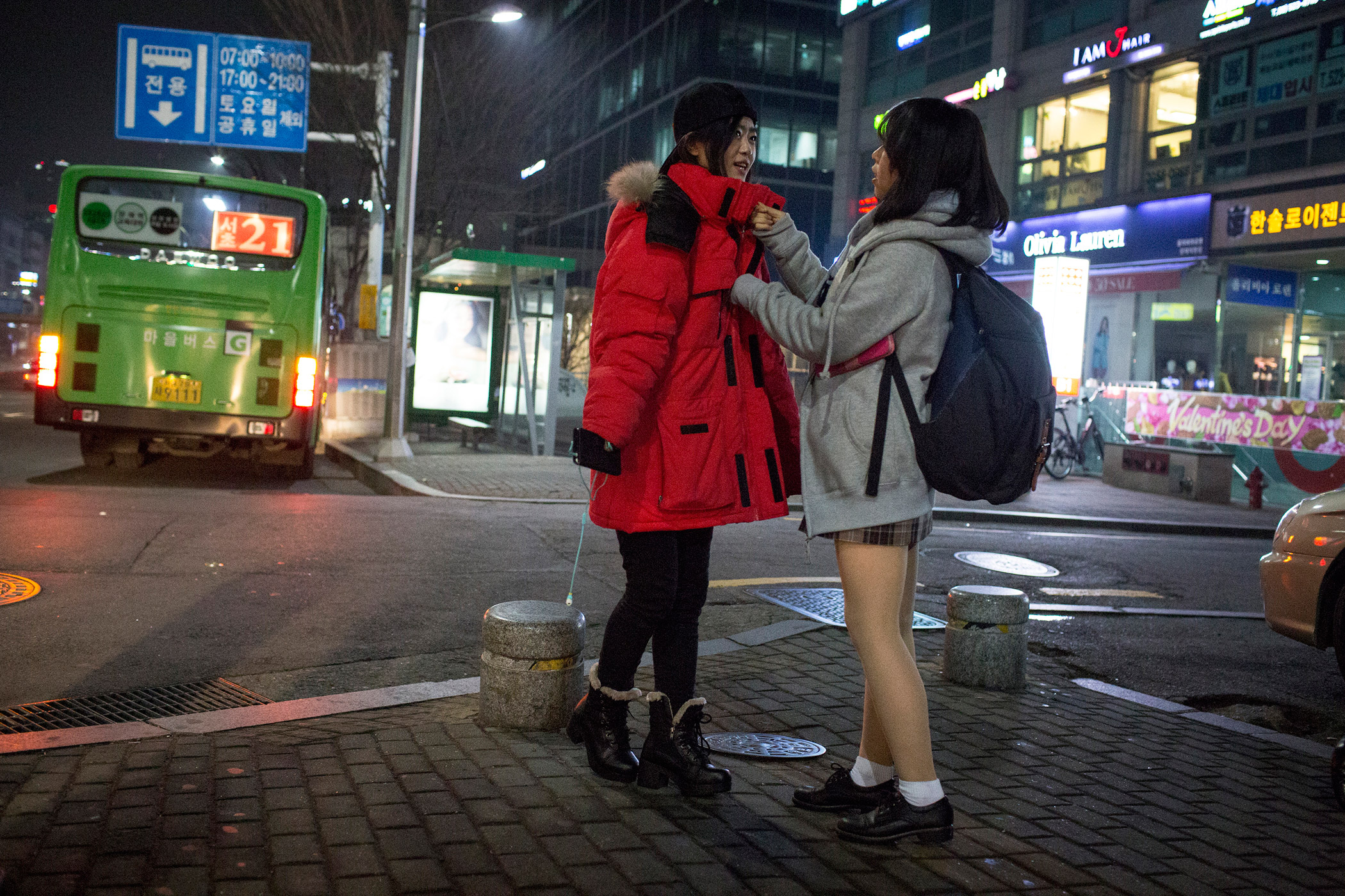 Kyoung-ok zips up Sarah's jacket during a night out Feb. 4, 2015 in Seoul, South Korea. The community of North Korean refugees is growing more tight knit with the help of social networks and human rights groups.