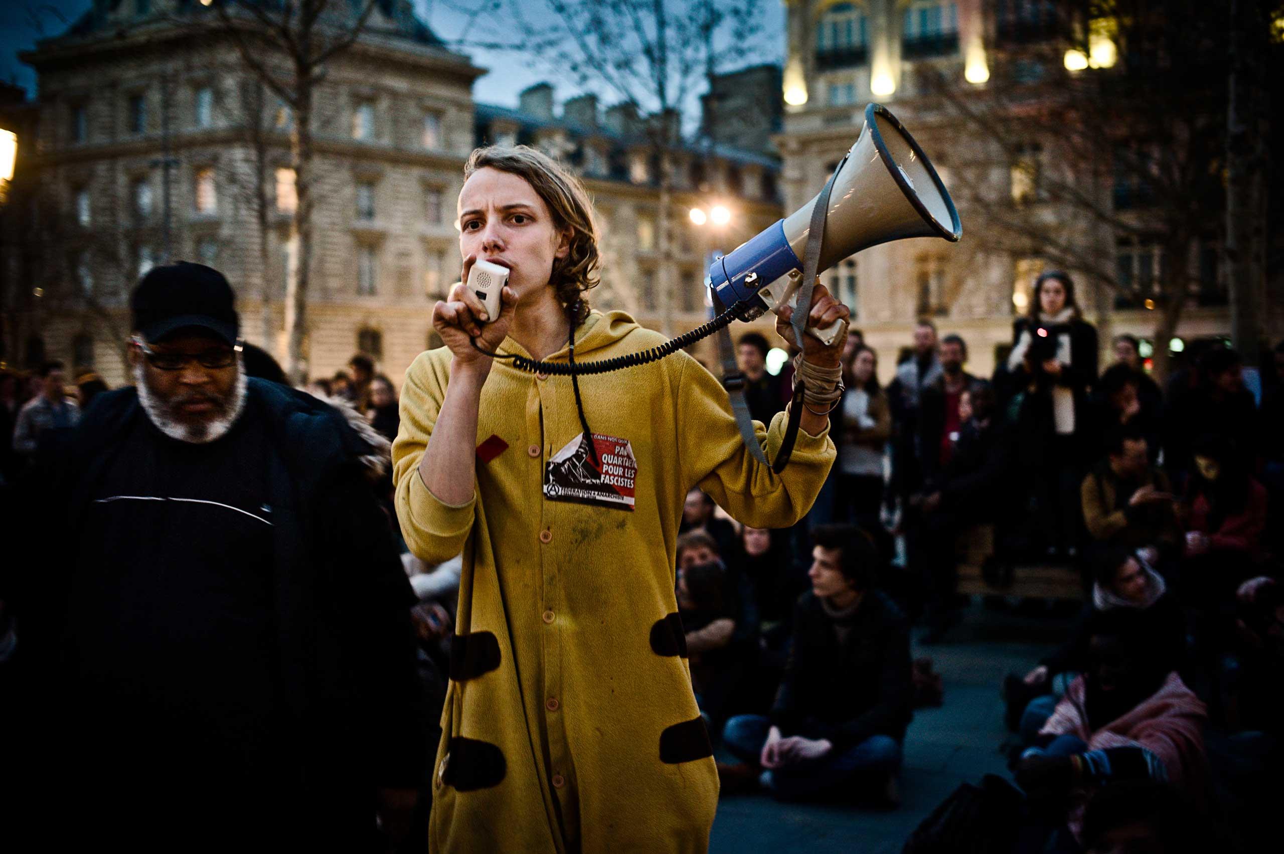A representative of the Nanterre University students  speaks to the crowds in the Place de la République.