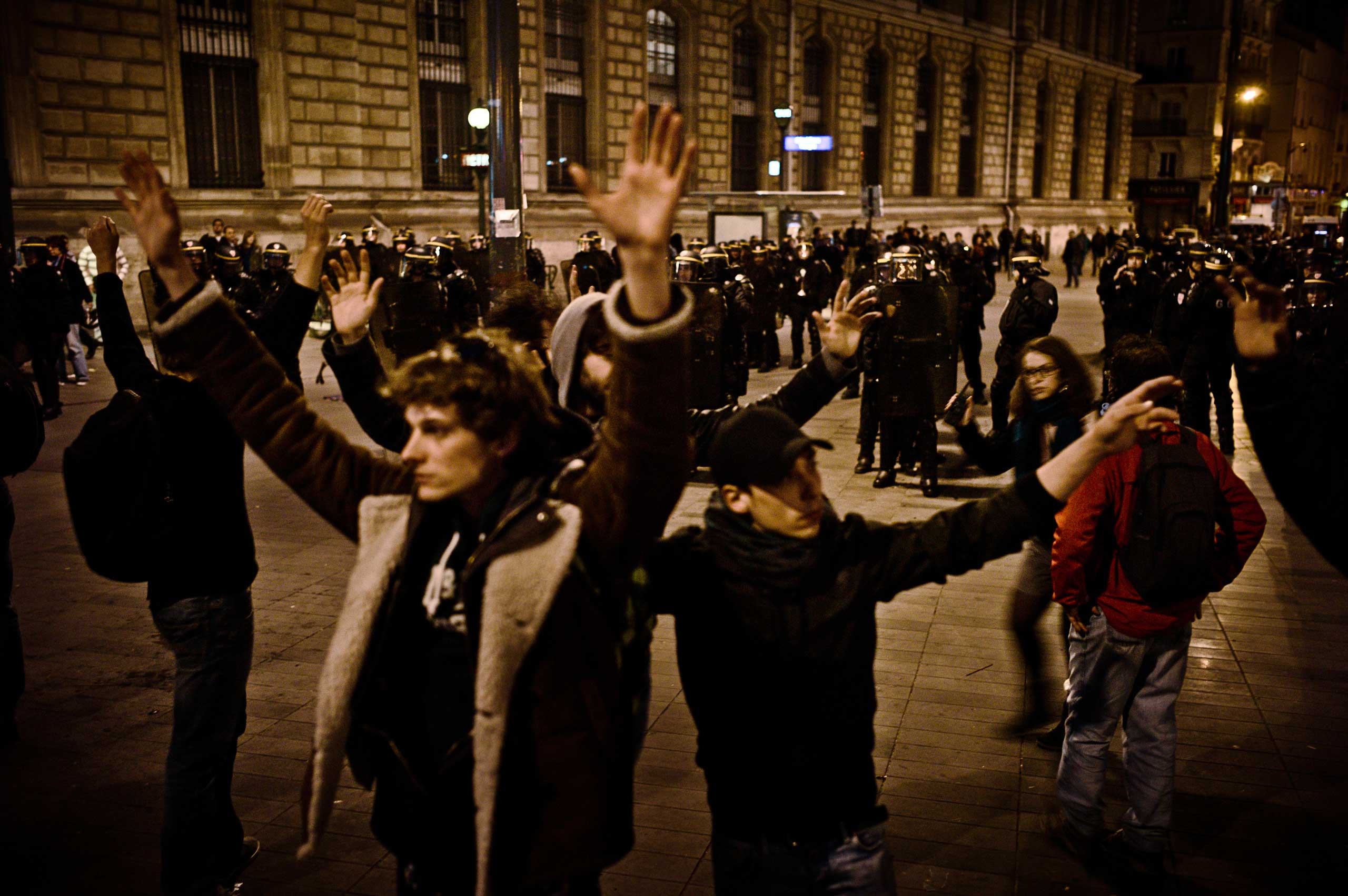 This evening ends earlier than expected due to riots. People from Nuit Debout stand between police and rioters, May 1, 2016.