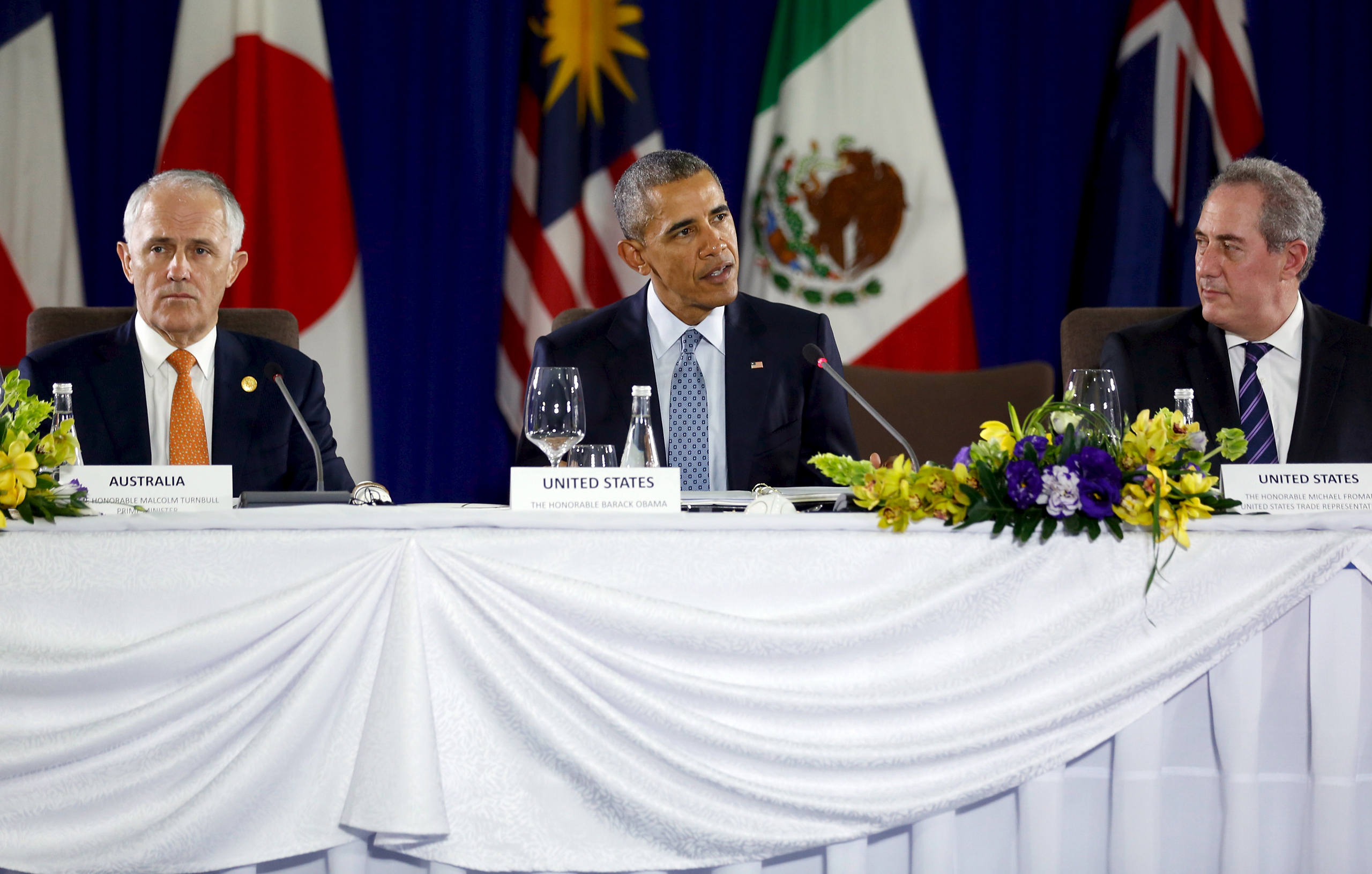 President Barack Obama, flanked by Australia Prime Minister Malcolm Turnbull (left) and U.S. Trade Representative Michael Froman (right), delivers remarks at a meeting with Trans-Pacific Partnership leaders, alongside the APEC Summit in Manila on Nov. 18, 2015.