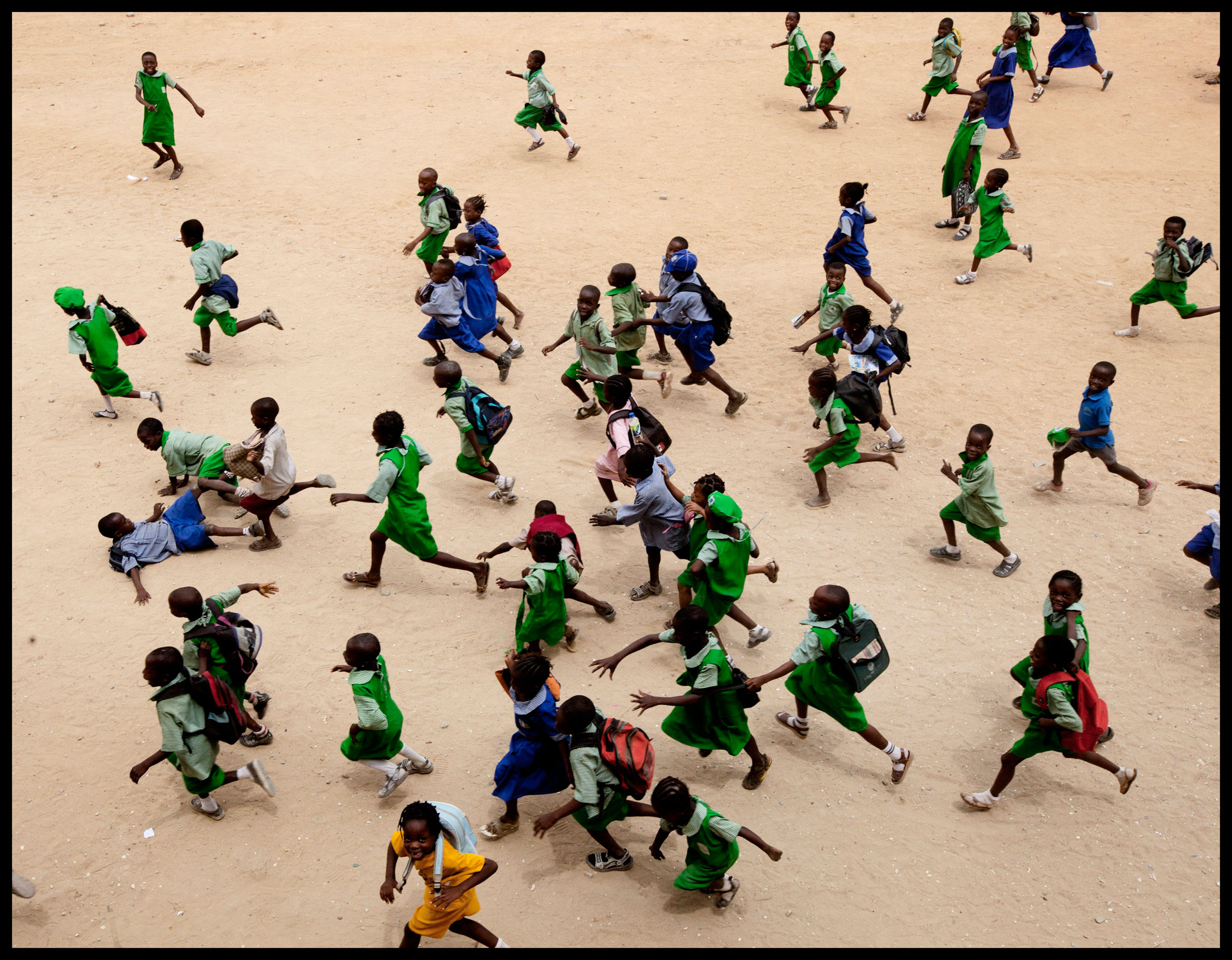 Children run at a school in Lagos. More African kids are finishing primary school, but that's just the beginning