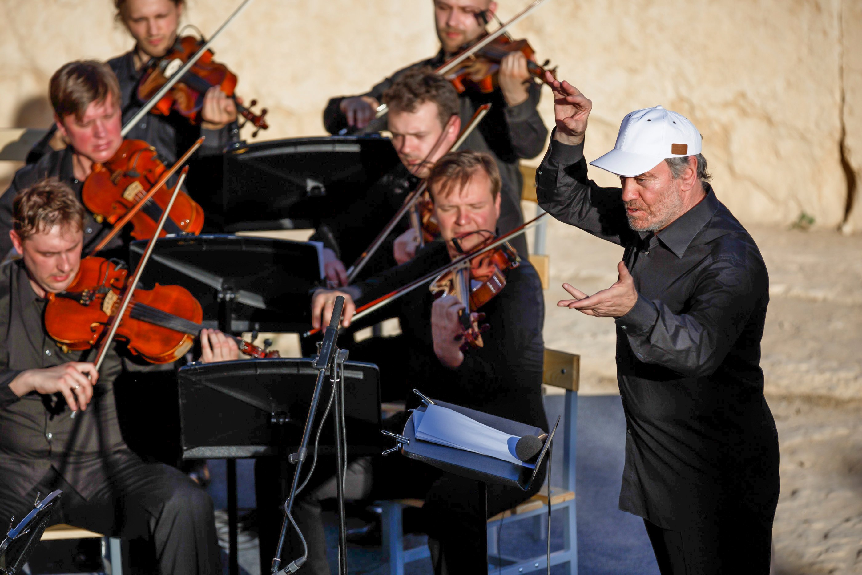 In this photo released by Russian Ministry of Defence, conductor Valery Gergiev leads a concert by the Mariinsky Theater Orchestra in the Palmyra amphitheater in Syria, on May 5, 2016.
