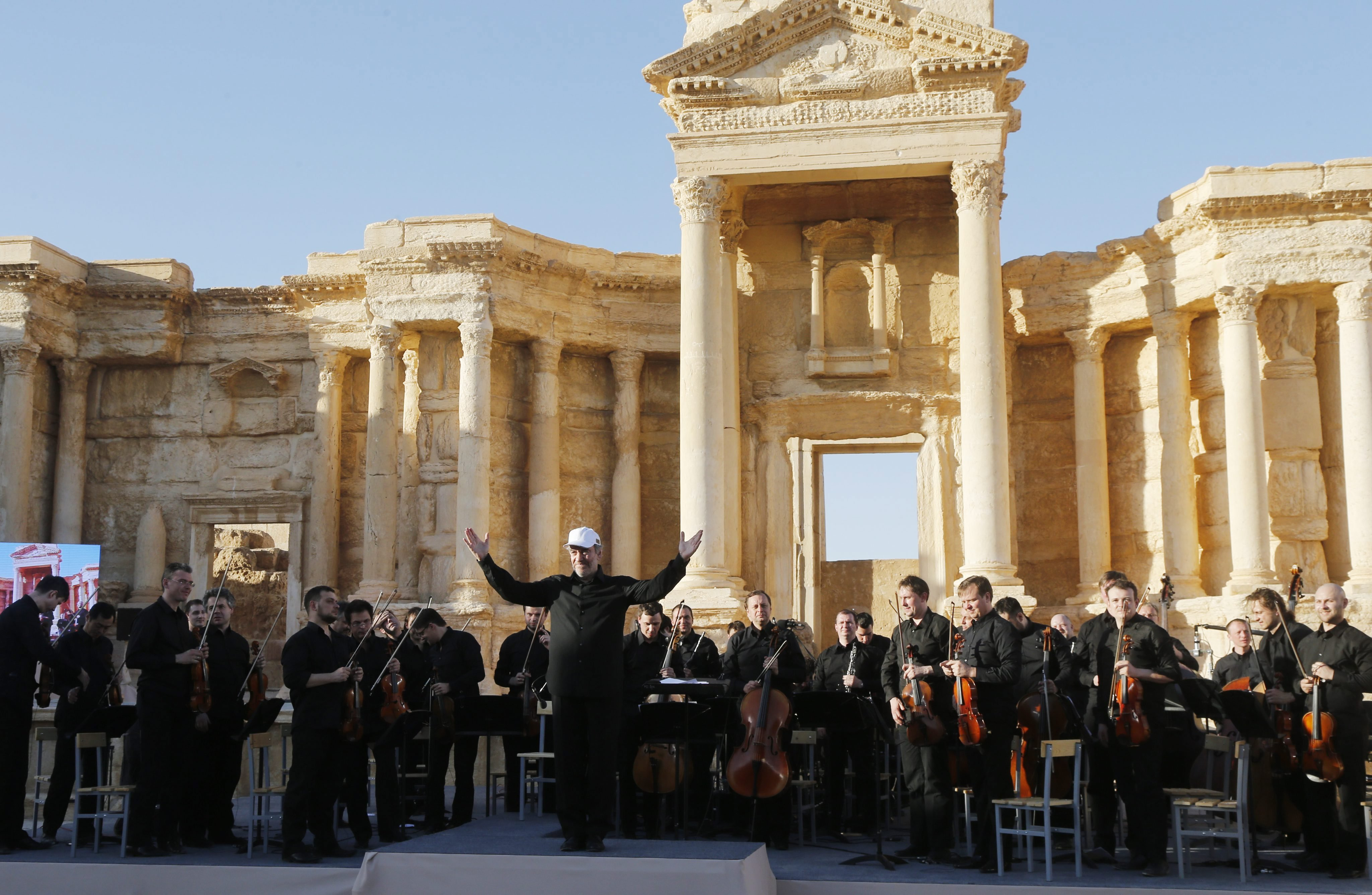 Chief conductor of the Mariinsky Theater Orchestra Valery Gergiev greets the public after a concert in in the Palmyra amphitheater in Syria, on May 5, 2016.