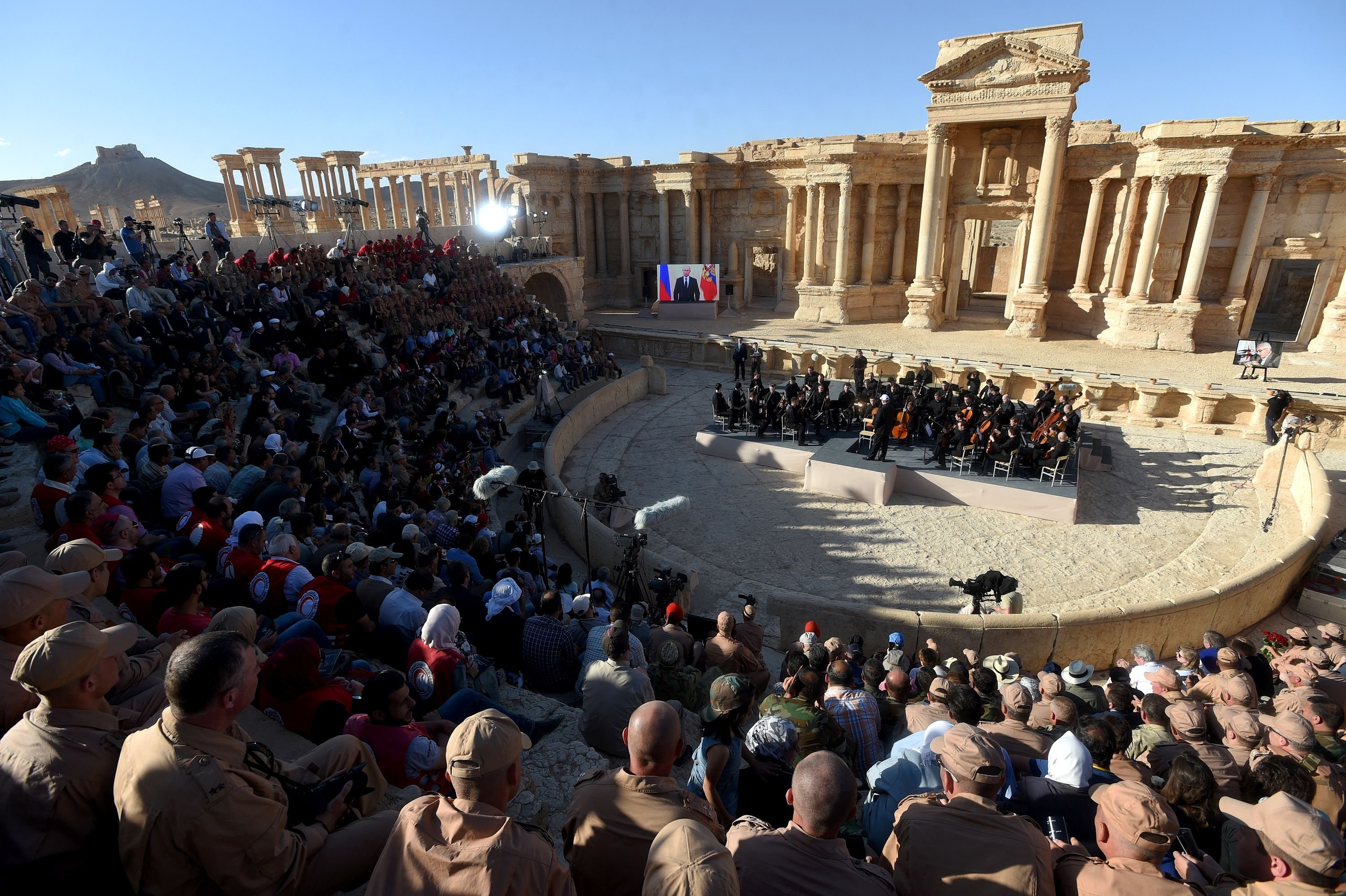 Russian conductor Valery Gergiev leads a concert by the Mariinsky Theater Orchestra in the amphitheatre of the ancient city of Palmyra on May 5, 2016.