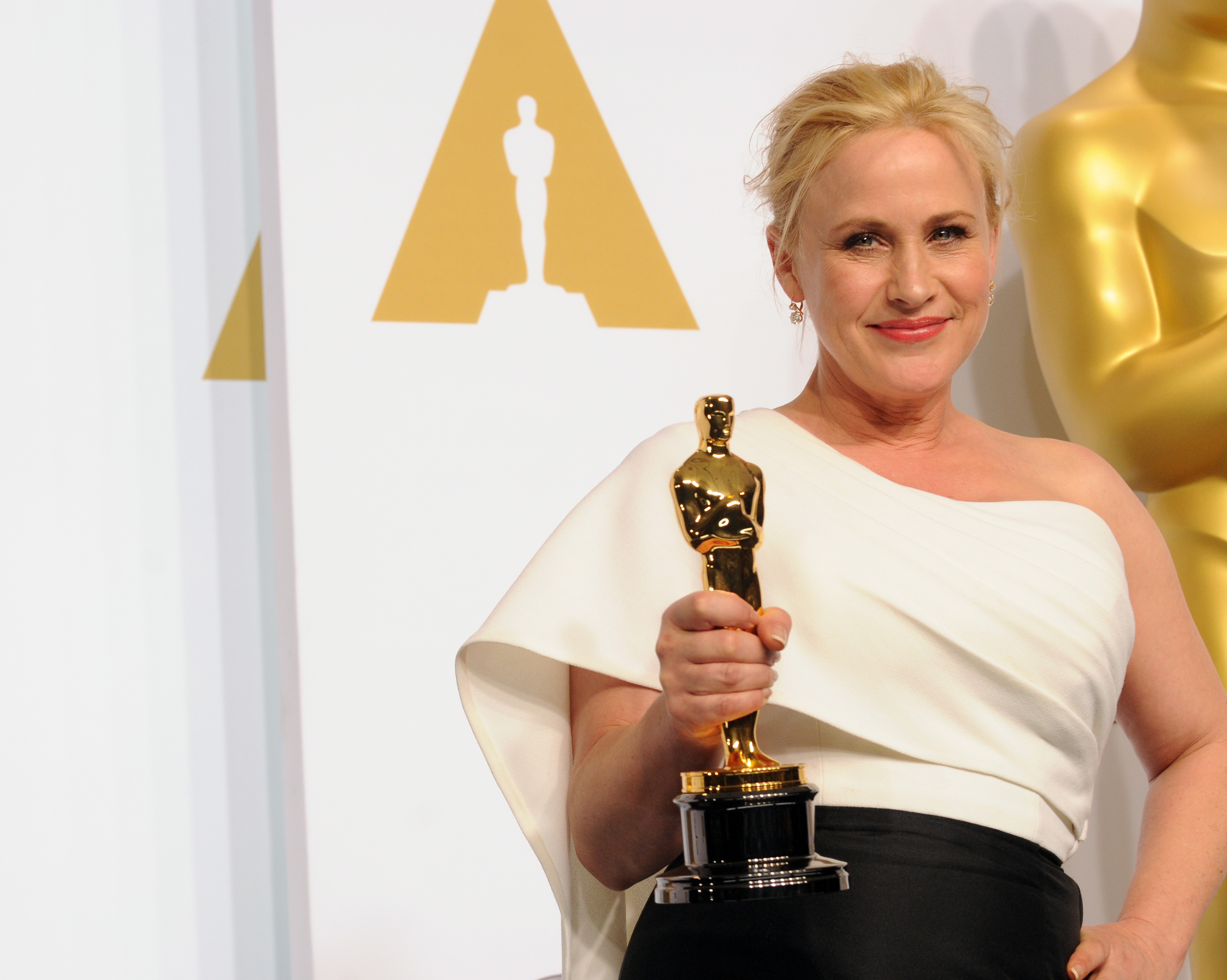Actress Patricia Arquette winner for Best Supporting Actress in  Boyhood  poses inside the press room of the 87th Annual Academy Awards held at Loews Hollywood Hotel on February 22, 2015 in Hollywood, California.