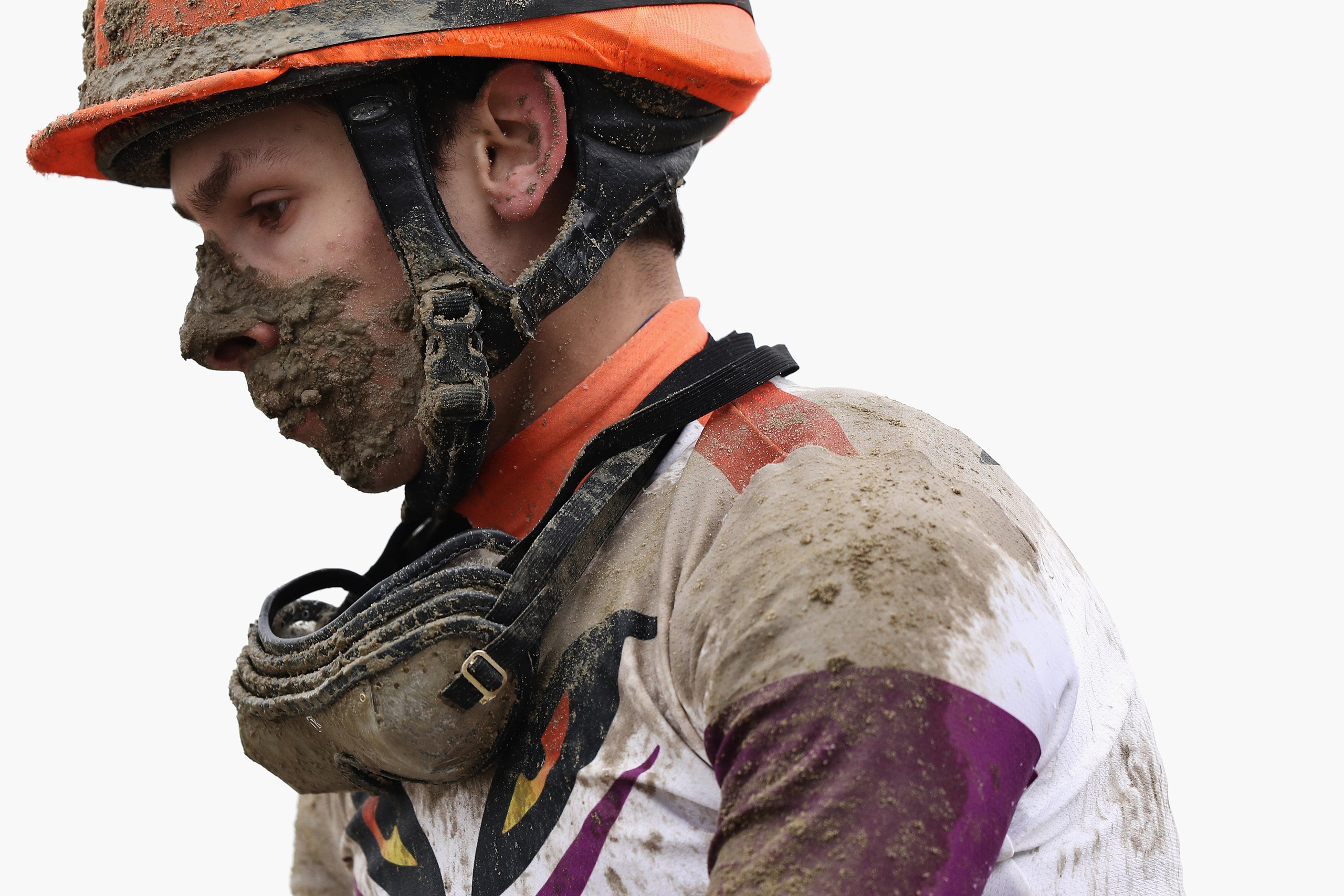 A jockey looks on after racing in a race prior to the 141st Preakness Stakes horse race at Pimlico Race Course in Baltimore, Md., on May 21, 2016.