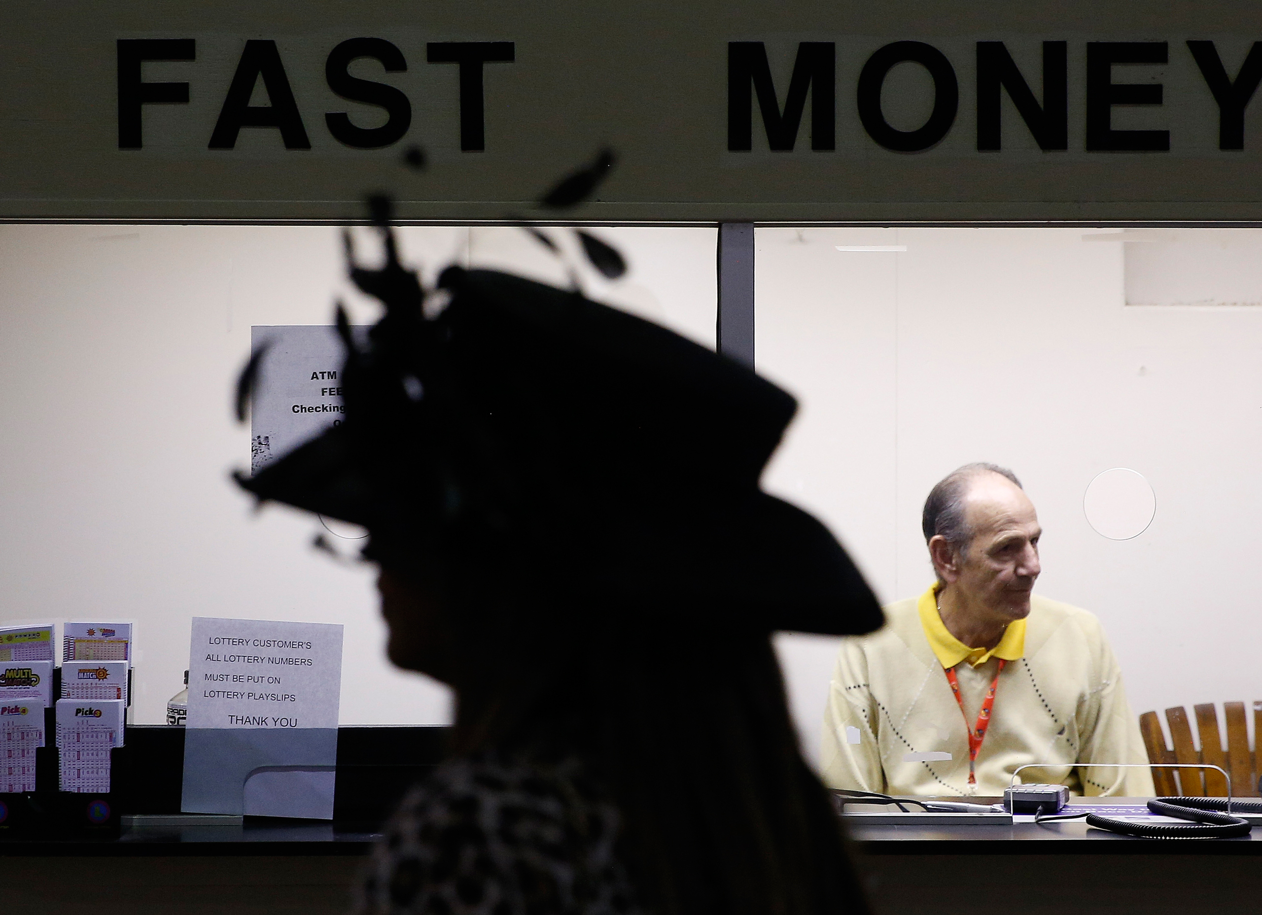 A woman passes a counter ahead of the 141st Preakness Stakes horse race at Pimlico Race Course in Baltimore, Md., on May 21, 2016.