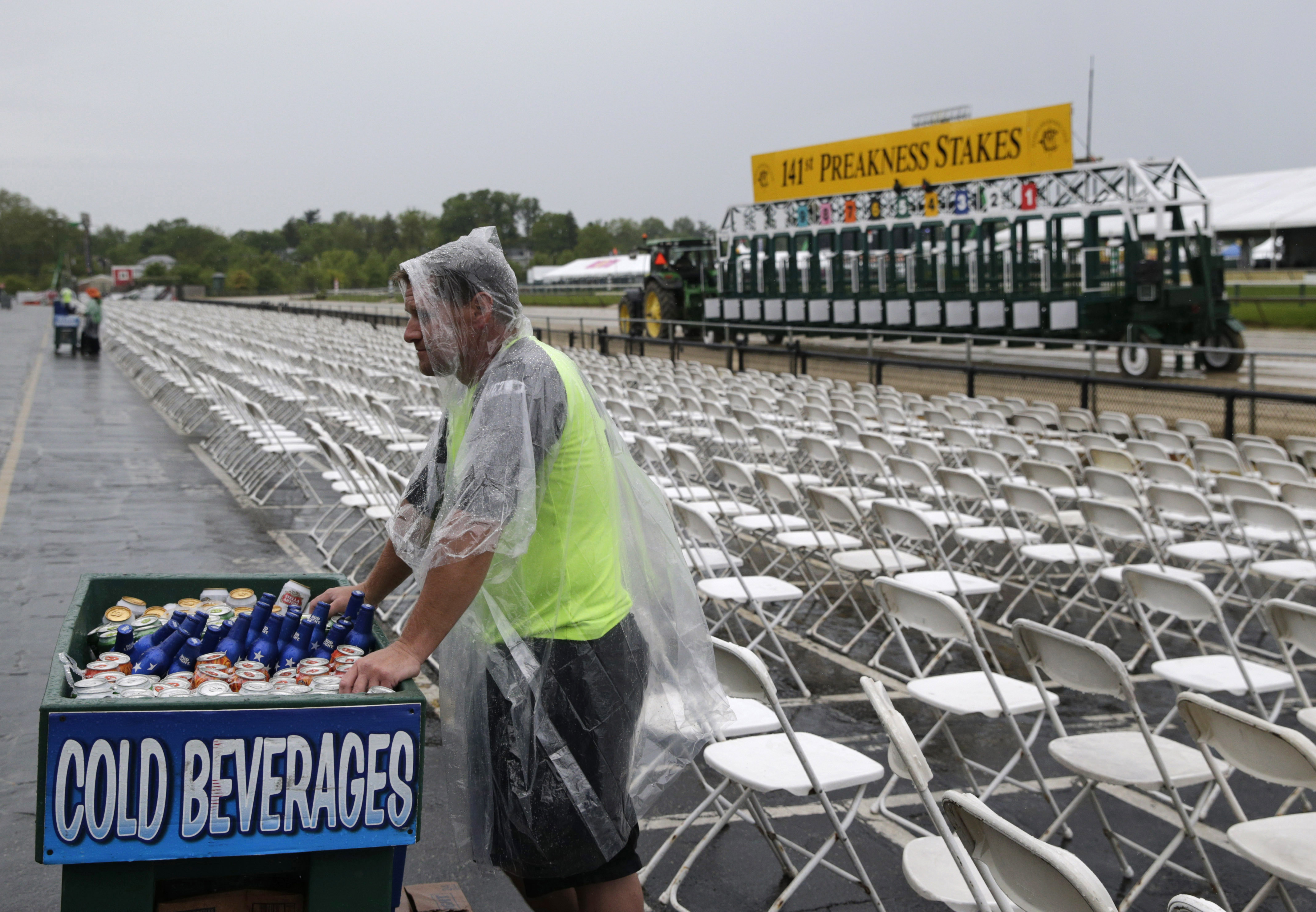 A beer vendor waits for customers as rain falls before the 141st Preakness Stakes horse race at Pimlico Race Course in Baltimore, Md., on May 21, 2016.